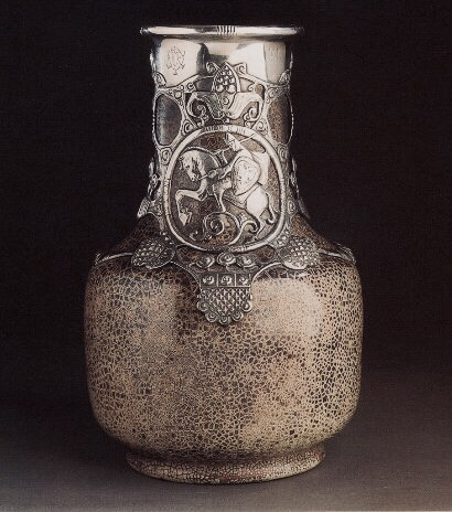 A Fabergé silver-mounted cEramiC vase by the StroganofF school, ca 1901. Sold christie's New york, april 18, 1996.