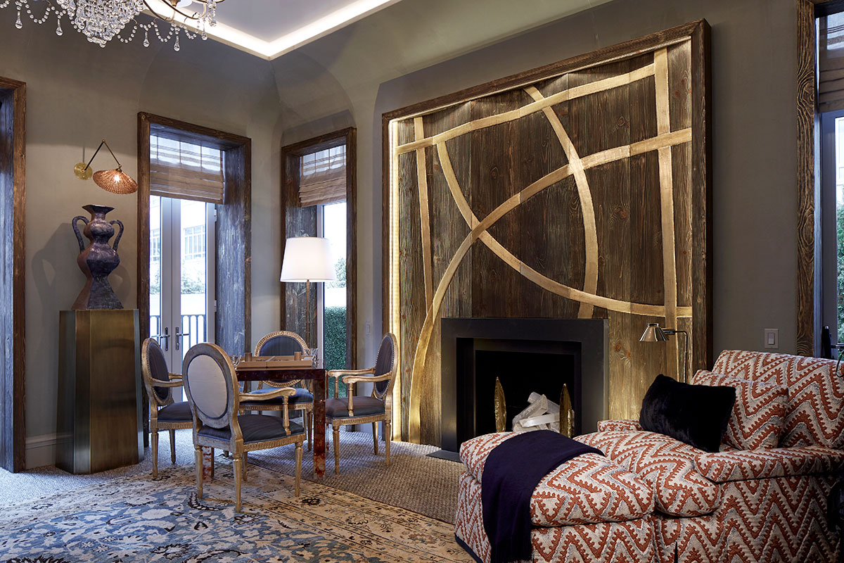 Embossed gold leaf fire place surround finished by Osmundo Studio for David Kleinberg