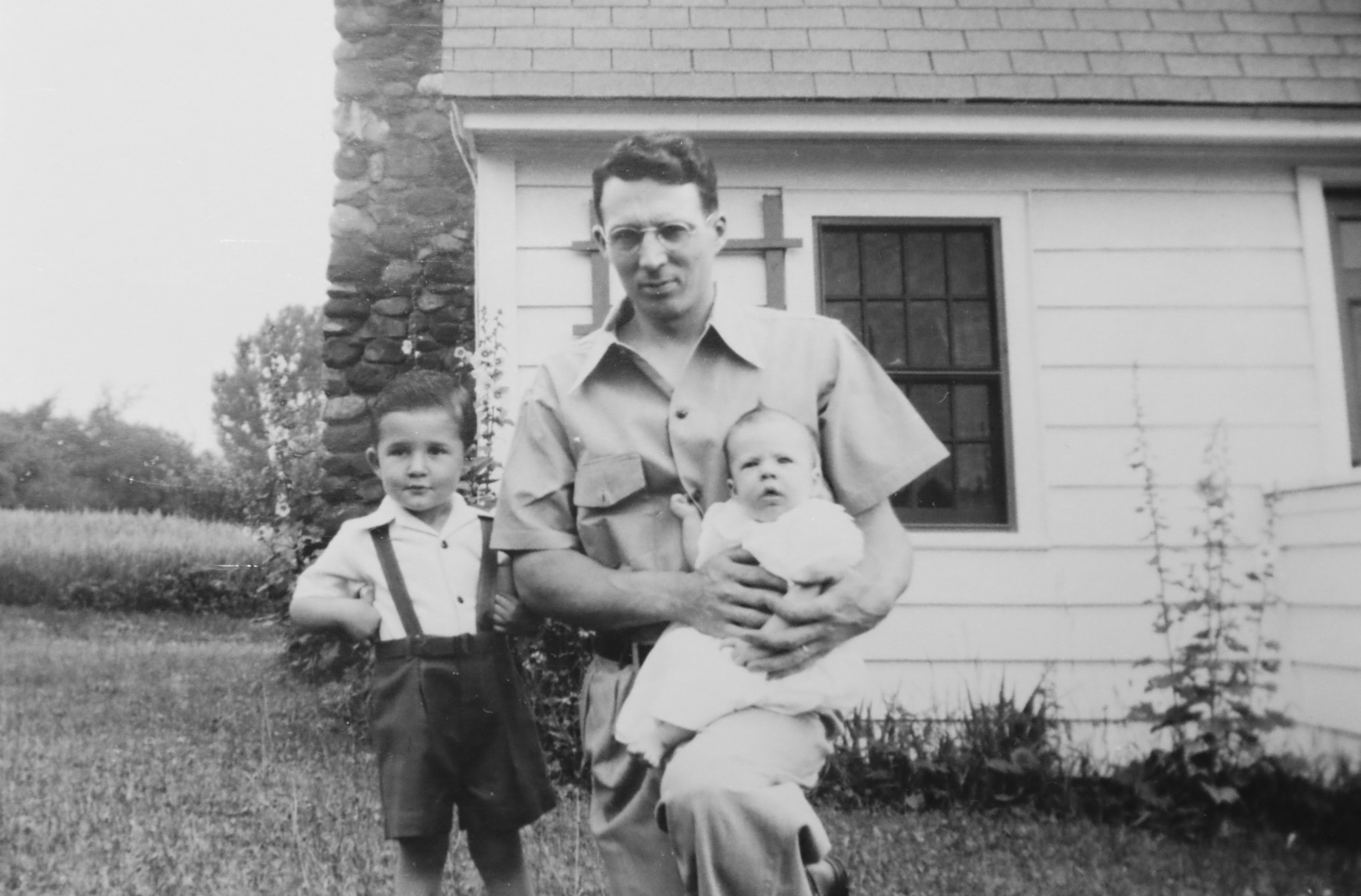 George Jr. (left) stands with his father and his brother Rodney in front of their house in Bloomfield, Connecticut in the early-1940s. (Archive)