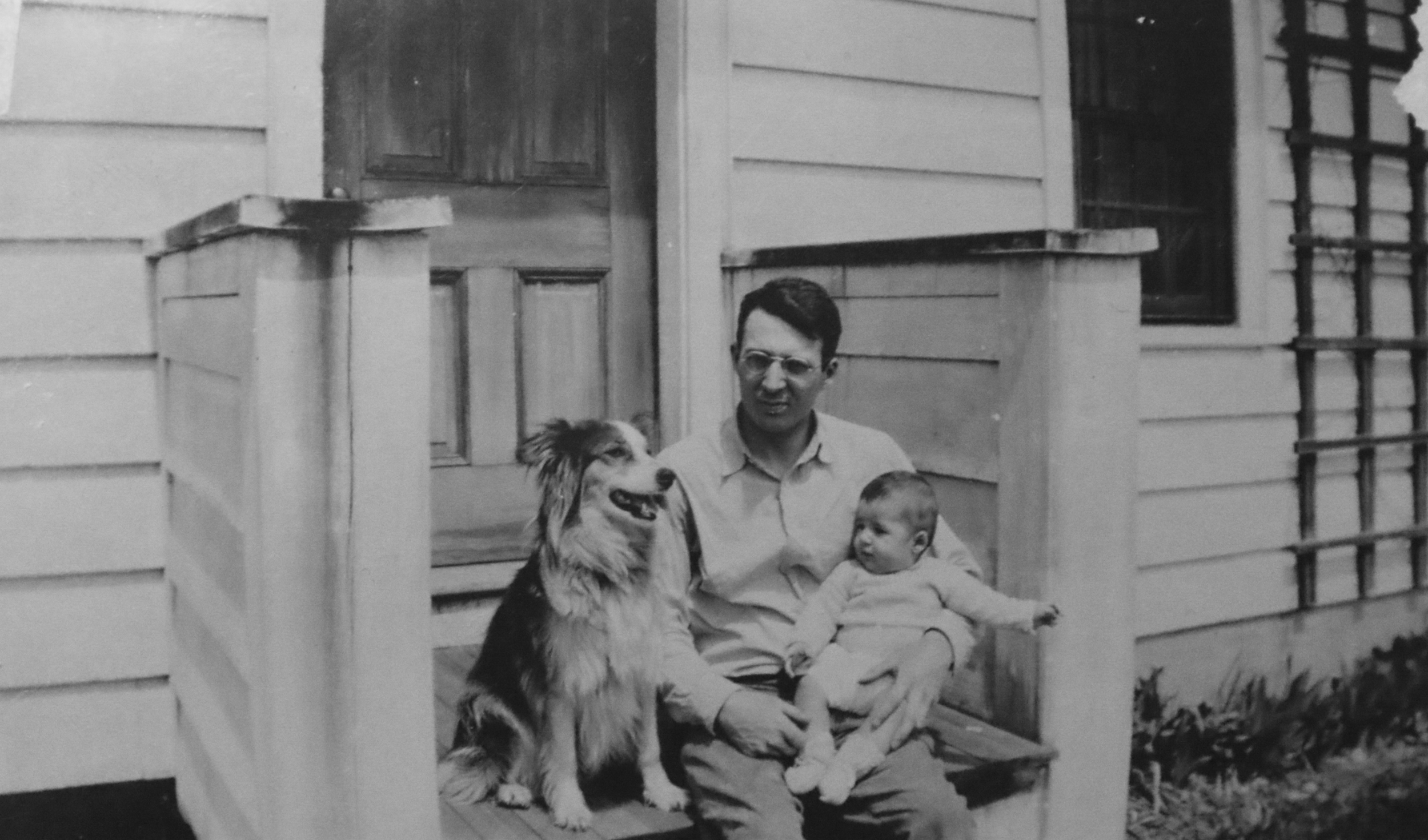 George Jr. is seen with his father and the family dog, a Border Collie named Twinkie, on the front porch of their home in Bloomfield, Connecticut shortly after George Jr. was born in 1940. (Archive)
