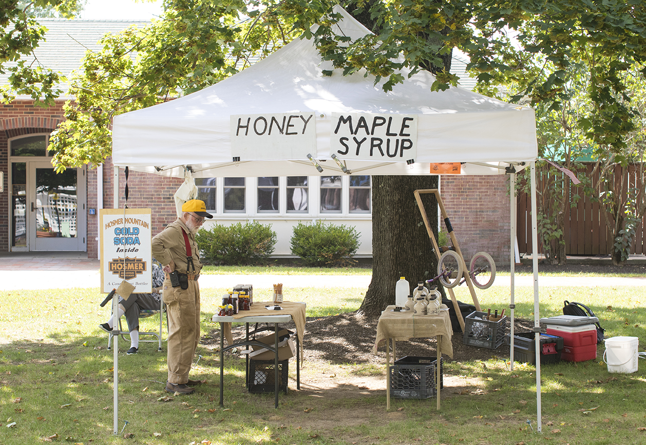 George surveys his setup at the Storrs Farmers Market before customers start arriving on Saturday, Sept. 19, 2015. George is always among the first people to setup at the market. (Jackson Mitchell)