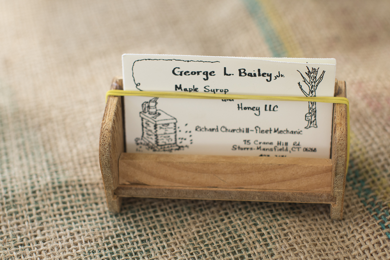 George's homemade business cards are seen on a table inside his tent at the Storrs Farmers Market on Saturday, Sept. 19, 2015. (Jackson Mitchell)
