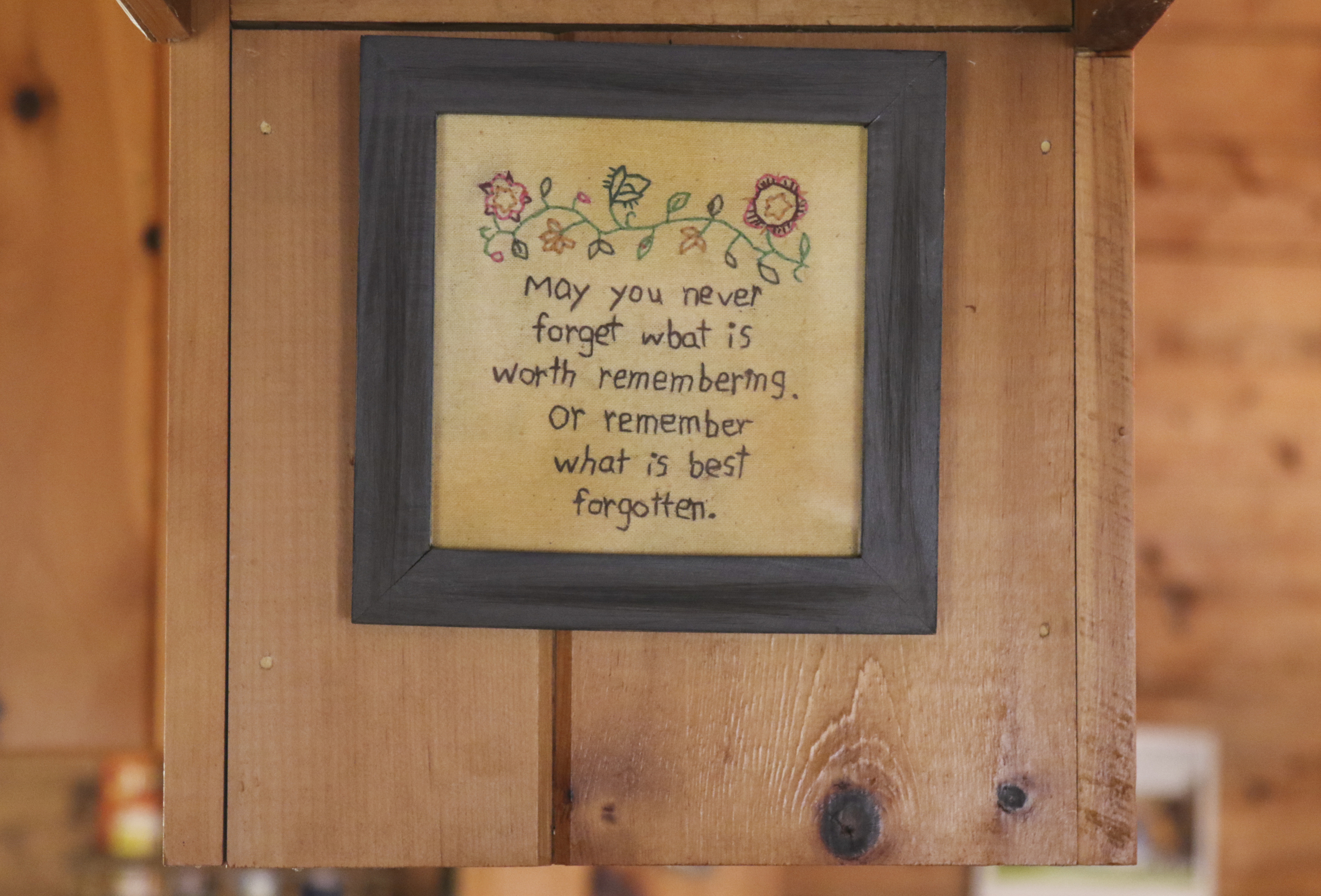 A needlepoint made by Ann is seen hanging above the Bailey's kitchen counter in their home in Mansfield, Connecticut. (Jackson Mitchell)