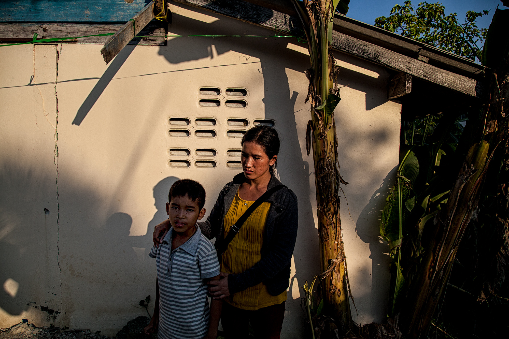 """Rhma Din, 27 year old with her son in Bangkok, Thailand, Feb. 4, 2017. A Vietnamese Montagnard now living in Bangkok. She escaped religious persecution, land grabbing and arbitrary arrests at the hands of the Vietnamese police. Persecuted because of their religion (they are Christian), the Montagnard community of the Central Highlands are often beaten, imprisoned and jailed. When her youngest son was kidnapped, she asked the police to investigate and they told her: """"You are a Christian so why don't you pray your God, surely he can help you now."""" A few weeks later, her son's body was discovered by the river. The perpetrators were never found. She escaped Vietnam in September 2016 after the authorities issued an arrest warrant claiming she had destroyed and burned the land that she was working on. She is in Bangkok today with her oldest son and husband living as refugees with no papers, as the Thai government does not recognize refugees. Her future is uncertain"""