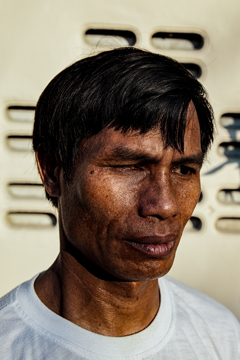 """Nay Hoch, 45, Bangkok, Thailand Feb.4, 2017. Arrested and beaten for practicing his religion, he was sentenced to five months in jail and forced labor - he was made to dig a sewer and drains buried deep underground - and beaten repeatedly.   Hoch was also arrested in Thailand for working illegally on a construction site (Thailand is not a signatory to the UN's 1951 Convention Relating to the Status of Refugees or its 1967 Protocol Relating to the Status of Refugees) and does not allow refugees to work.  """"It's hard to live in Thailand because I'm a man and I cannot work to feed my family,"""" says Hoch"""