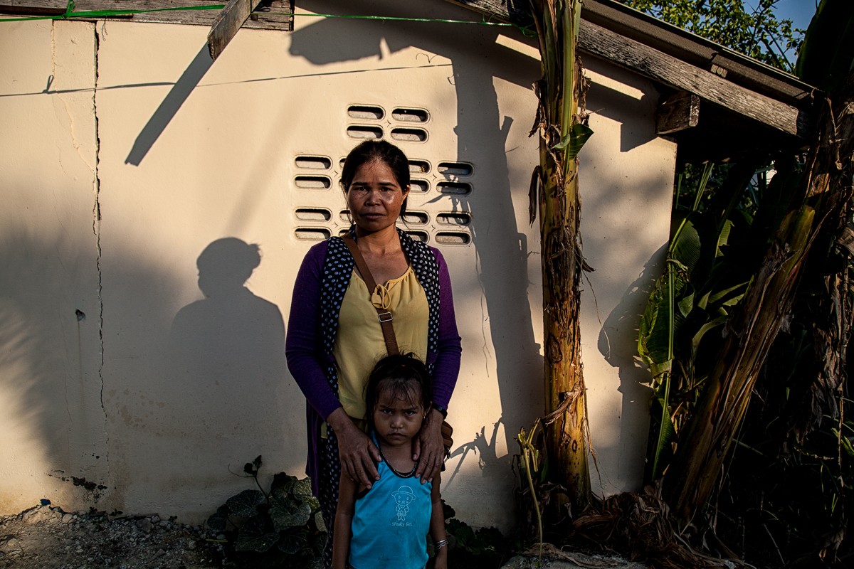 Hin Rmah, 36 with her daughter, Bangkok, Thailand, Feb.4, 2017. Her husband left Vietnam on Dec. 14, 2013 after the government took their land, leaving them unable to work. She was repeatedly questioned, jailed and beaten as retribution for her husband leaving. She escaped Vietnam thanks to the help of a couple she met at a hospital and they drove to the border where she was able to cross Cambodia and then Bangkok. 3 of her children are still in Vietnam.