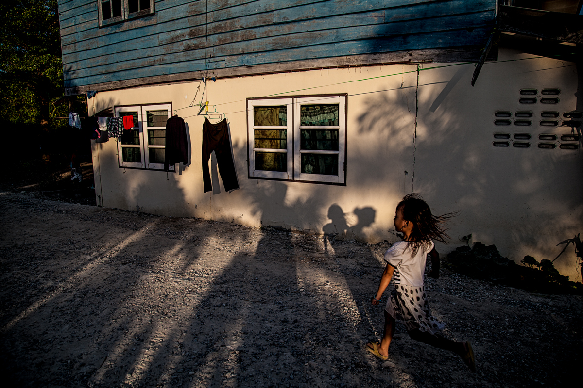 Bangkok, Thailand, Feb.4, 2017. Inside the compound where the Montagnards live, children are playing with one another.