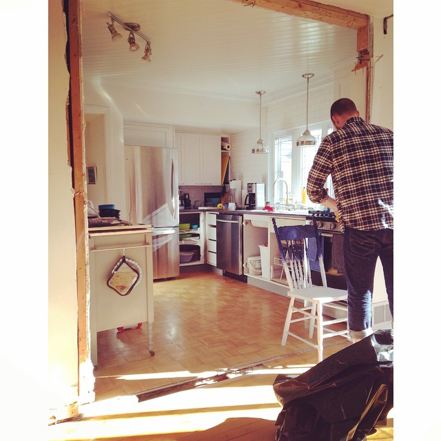 """Action shot of Chris hard at work. The wall is gone! The """"in progress"""" view from the dining room to the kitchen."""