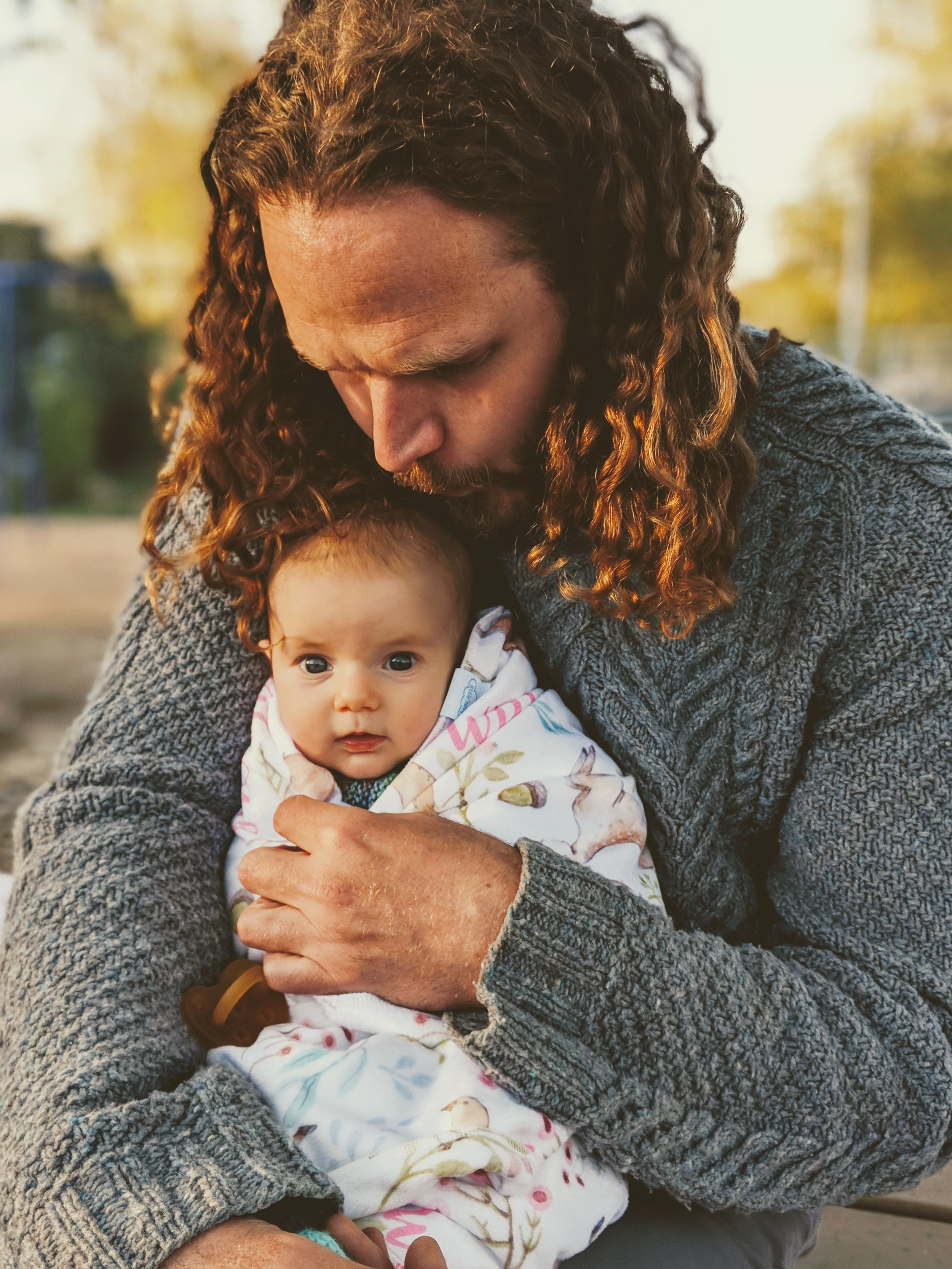 This photo makes my heart skip a beat every time I see it. Chris' luscious locks, his sweater, the golden hour lighting and of course that precious baby face. Chris is such a great dad. This ones a framer.