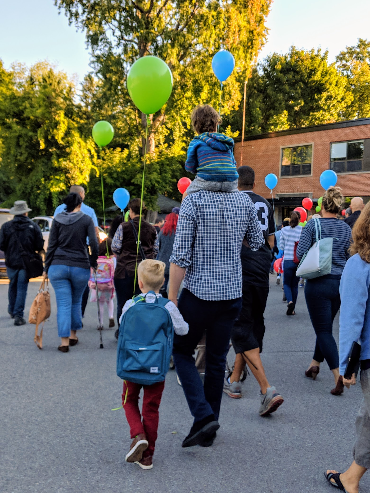 The balloon parade for Rowan's  first day of kindergarten ! Notice how he and Chris have the exact same gait.