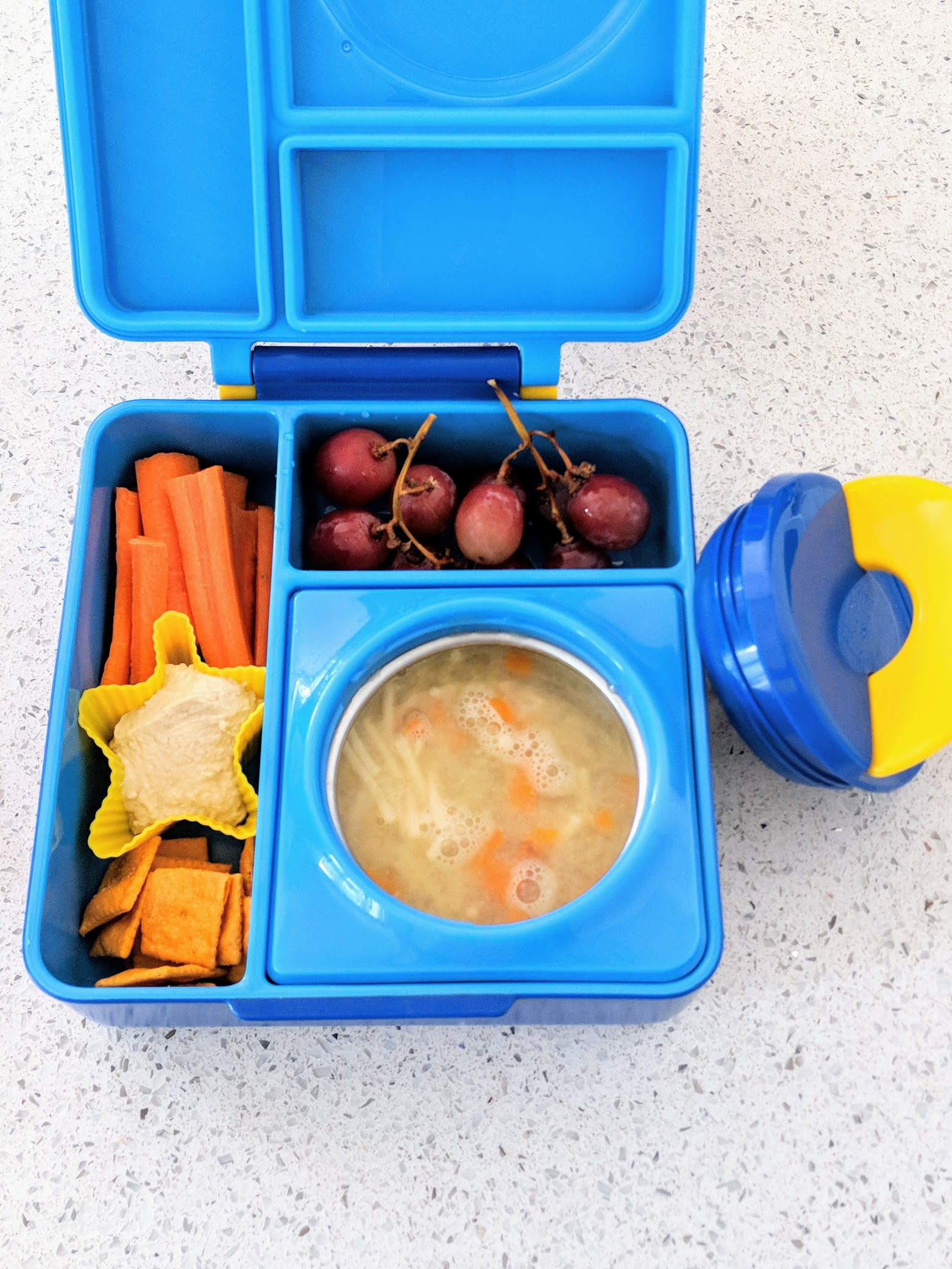 When Rowan and I went lunch box shopping he was very specific about wanting a bento box AND a thermos. I was thrilled when I found  this one by Omie at Well.ca . It wasn't cheap (although it was on sale when I bought it), but it's awesome. We're only one week in, but so far it's gotten rave reviews from Rowan.
