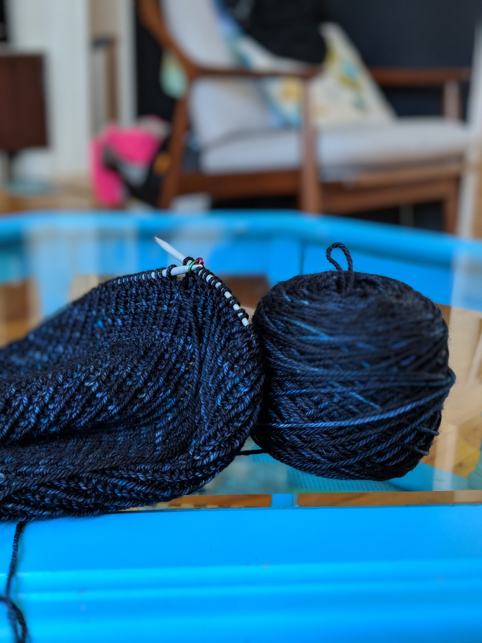 I'm knitting a  Roku  hat in the most beautiful OOAK skein of blue/black.