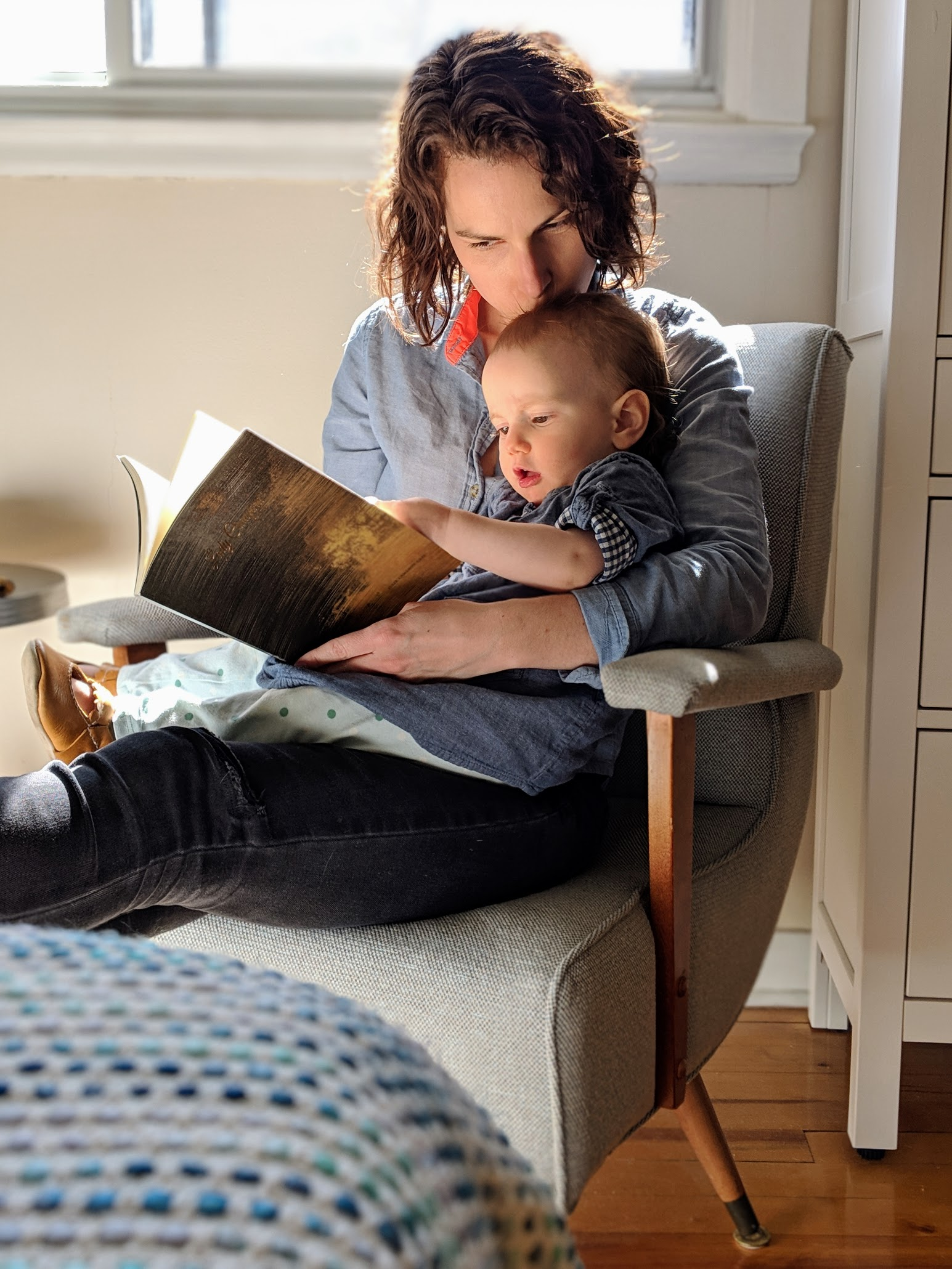 Mommy and Willow catching up on some poetry. ( Book by Julie !)