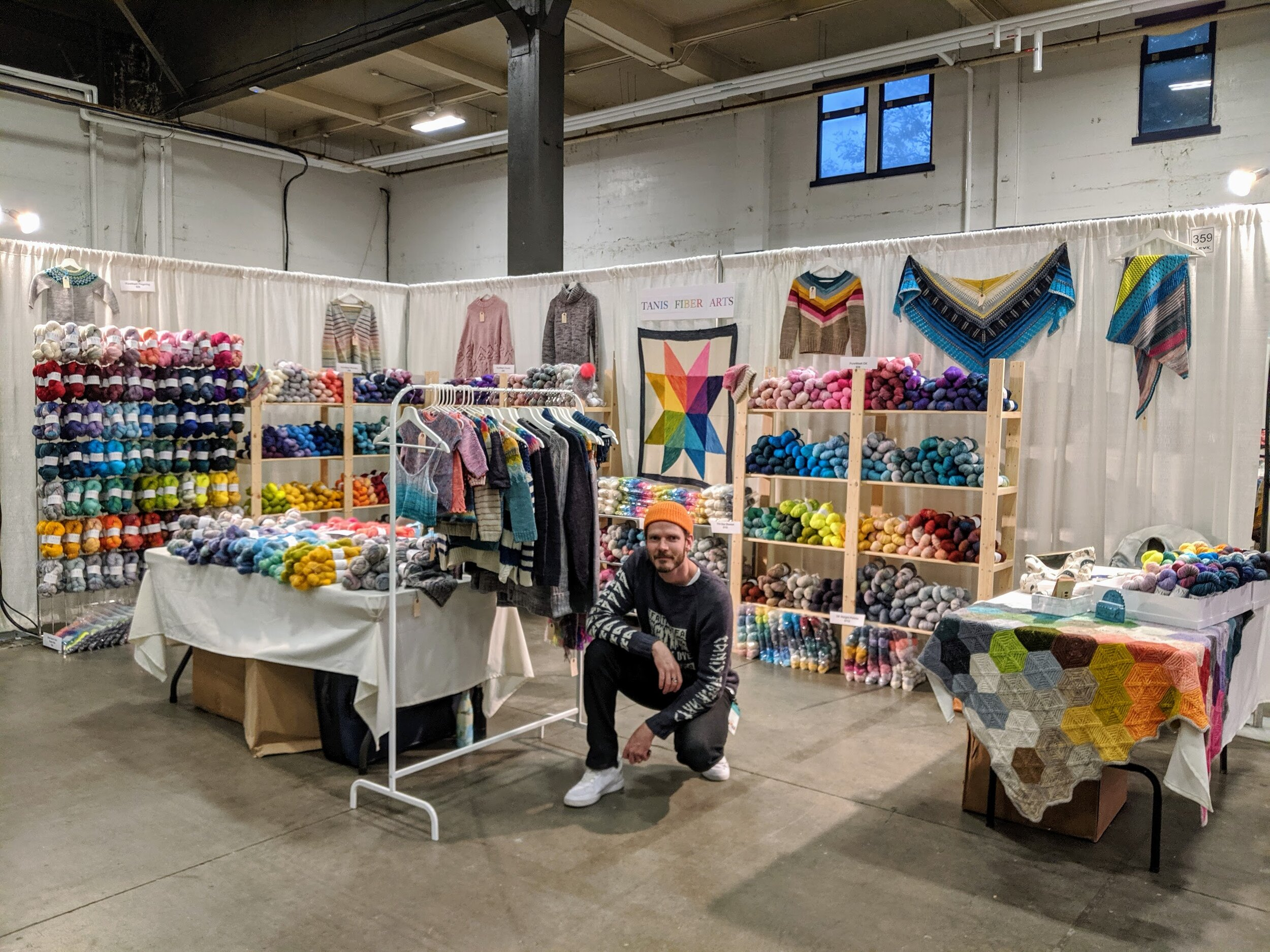 Chris workin' the booth! I love seeing all of our yarns displayed like this. It's a wee bit crowded but… SO MUCH COLOUR!