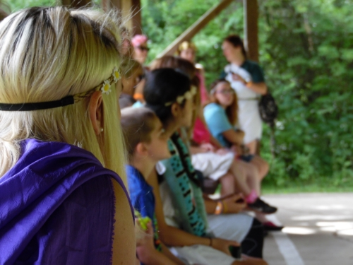 Kids at MDA Summer Camp wait for their turn on the archery and riflery range