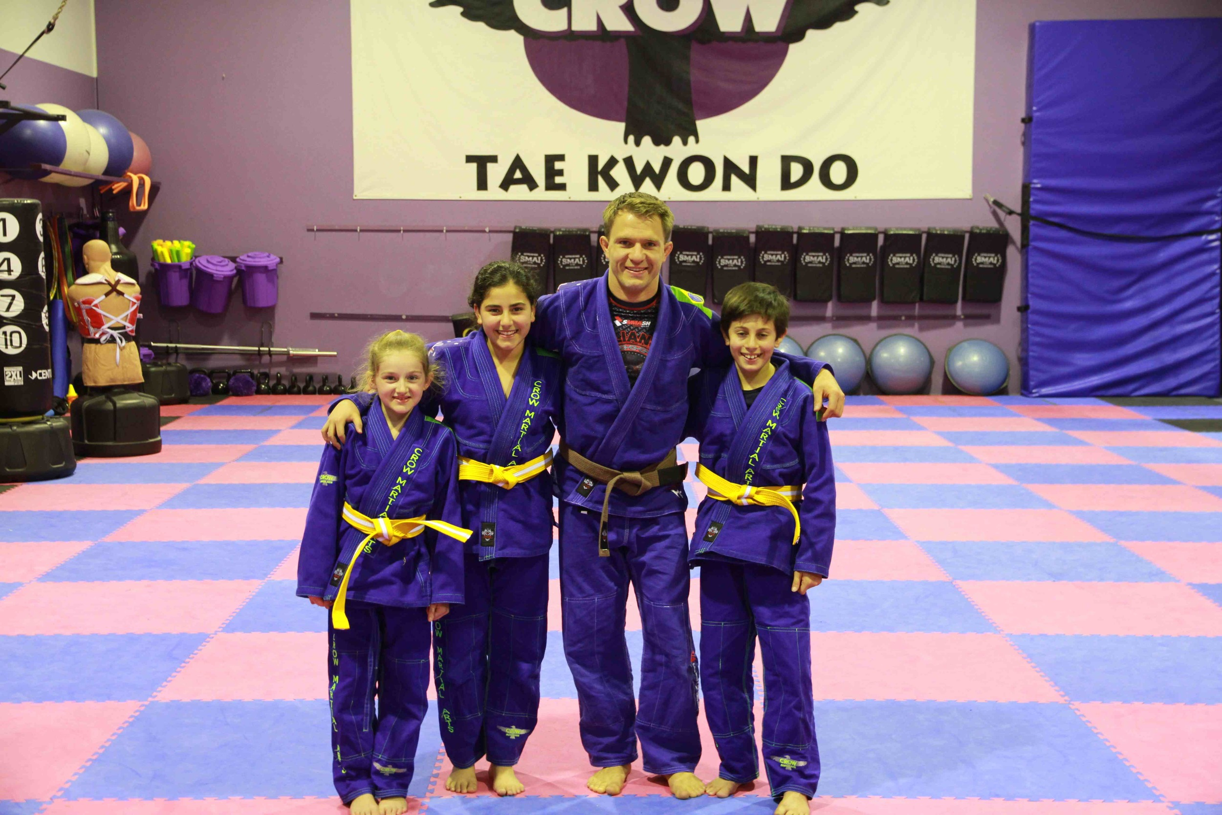 Charlize, Jasmine and Mihalis with head instructor Tim
