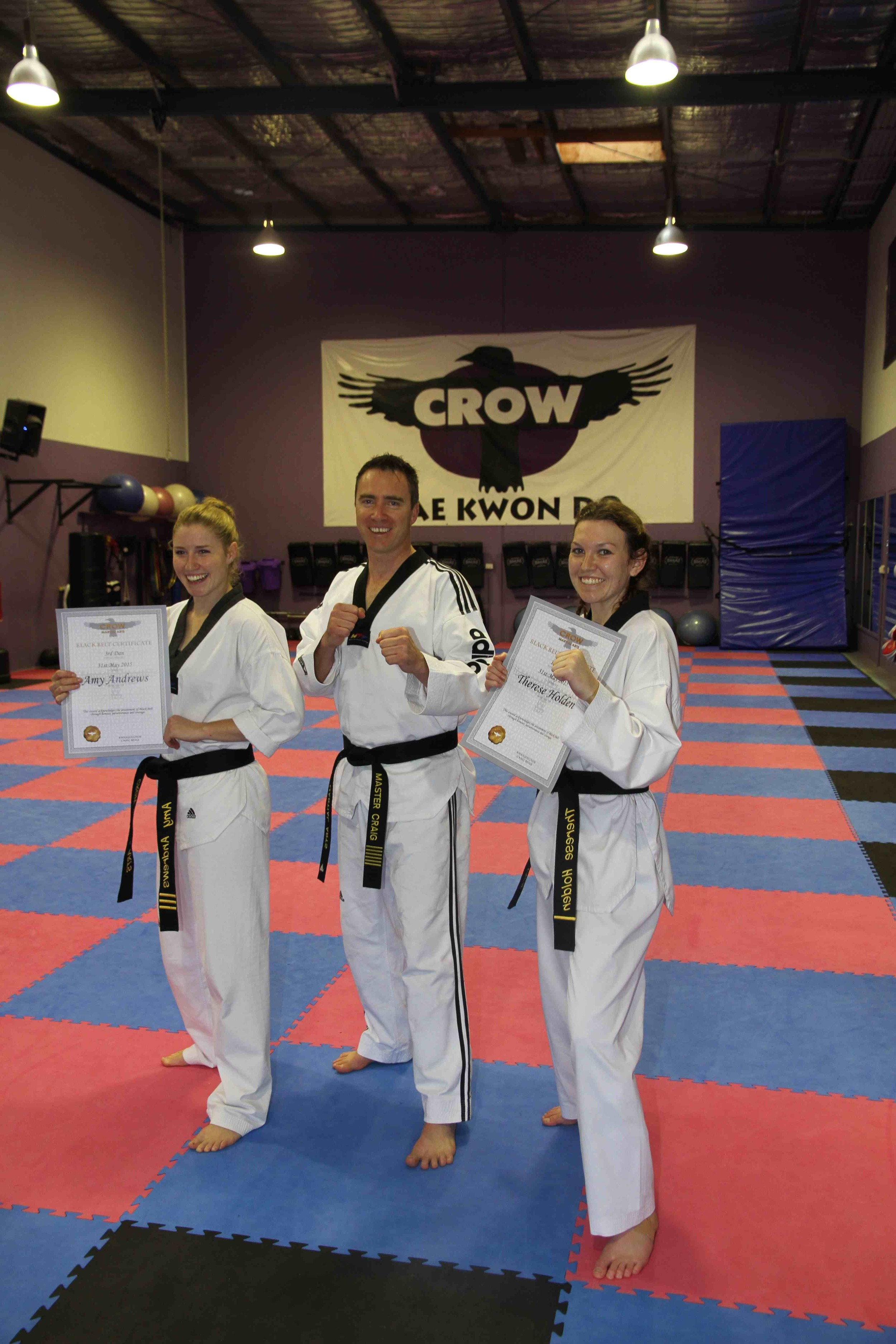 Master Craig with our successful girls Amy(l) and Therese(r) after the grading