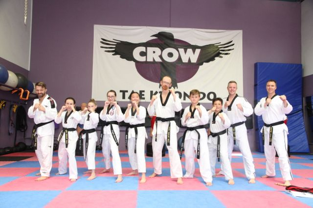 Our new black belts with the instructors after the grading