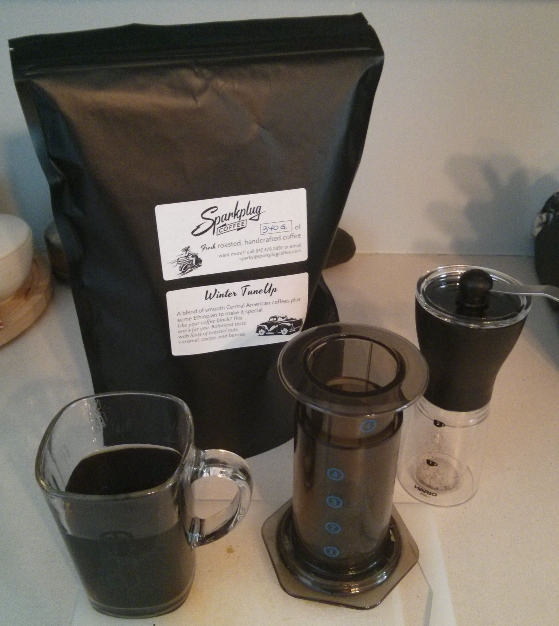 Darryl's first order from Sparkplug Coffee - hand grinder, Aeropress, naked coffee - a real coffee lover!