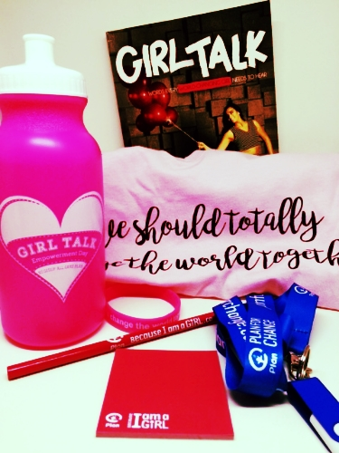 """Some of the merchandise items we picked up at GirlTalk Day. The t-shirt reads """"We should totally change the world together"""" and captures the essence of the empowering conference."""