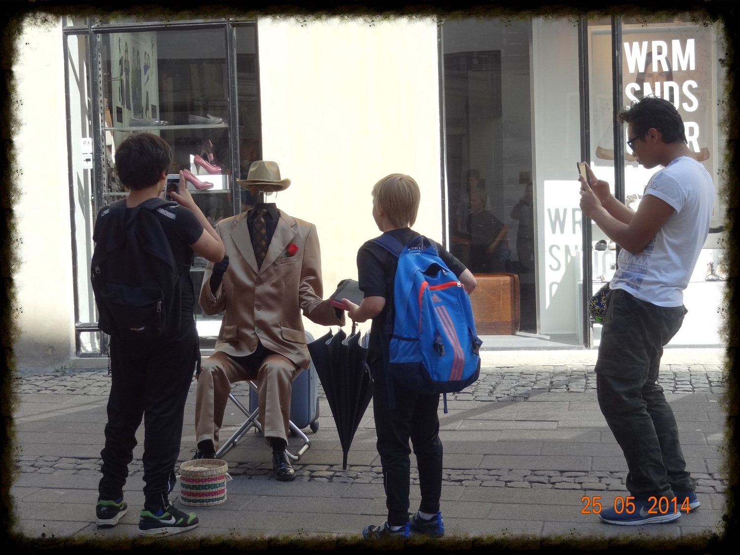 Students amused by street entertainment in Copenhagen this morning.