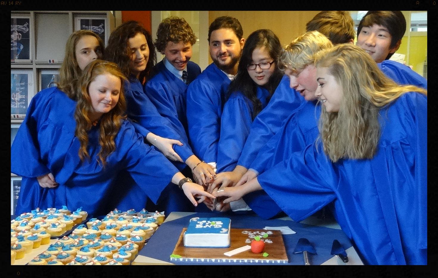 The seniors preparing to cut the cake.