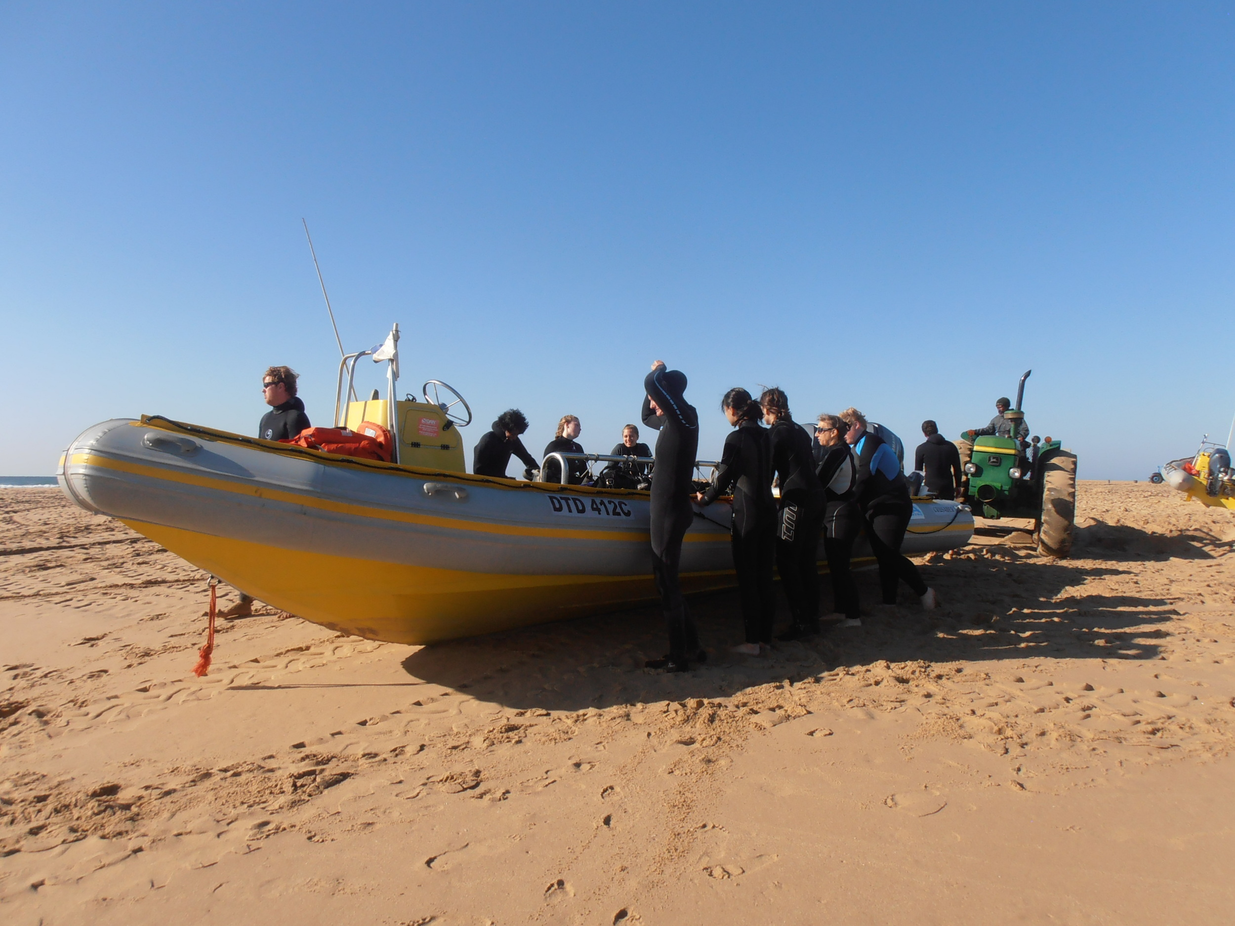 Preparing to launch our boat.  We walk beside it until it is afloat and then scramble into the boat for take-off.