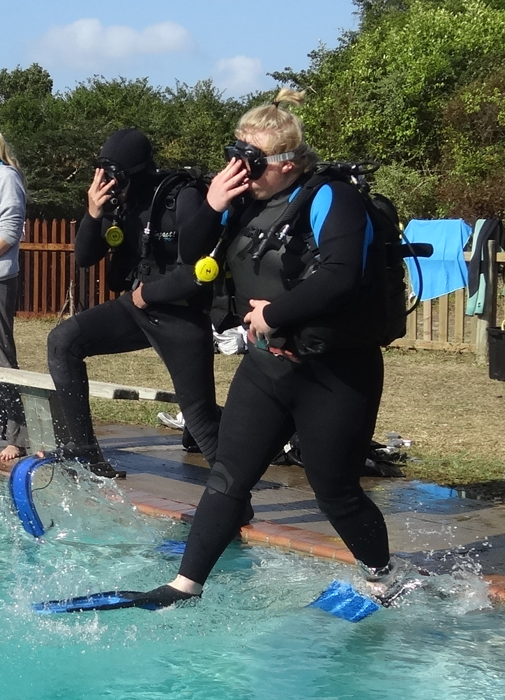"""As a diver, you need to know how to enter the water several ways, including """"walking in"""" to deep water as shown here. As a diving student you must perform each method for the instructor."""