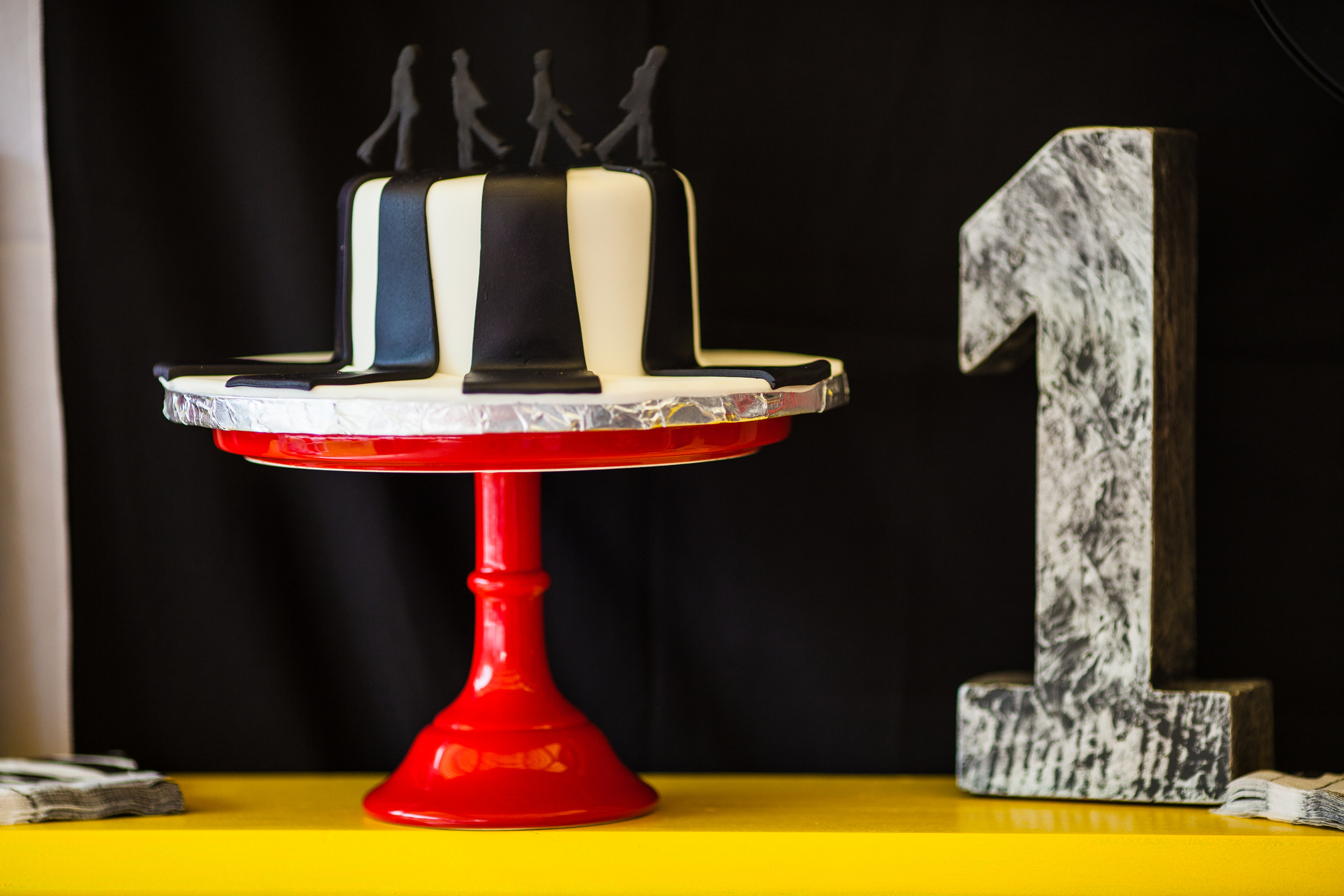 Cake by  Singer Sister Sweets . The number one and cake stand were purchased from Home Goods.