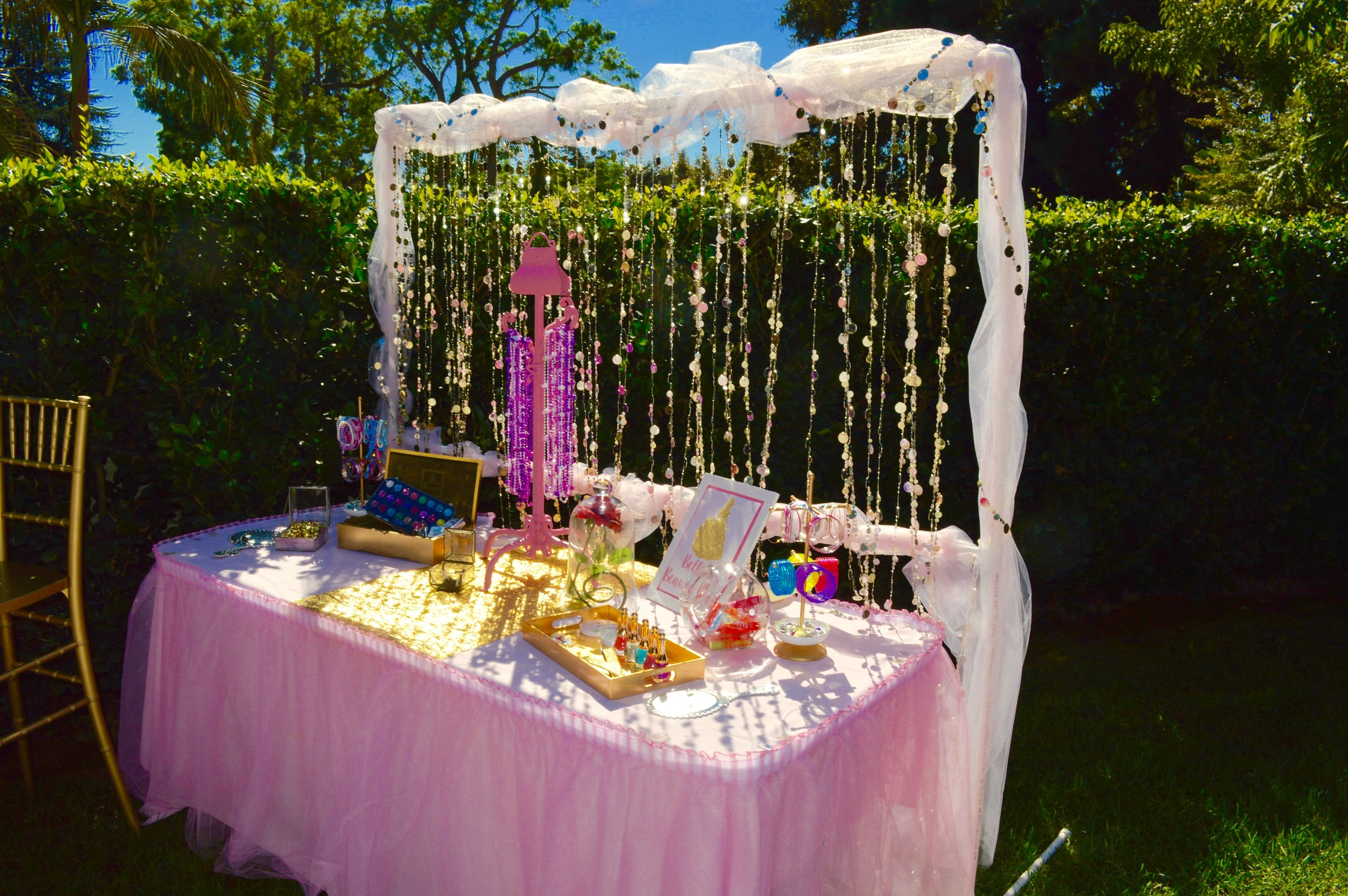 Belle's Beauty Bar feature a gold jeweled backdrop that shimmered in the sun.