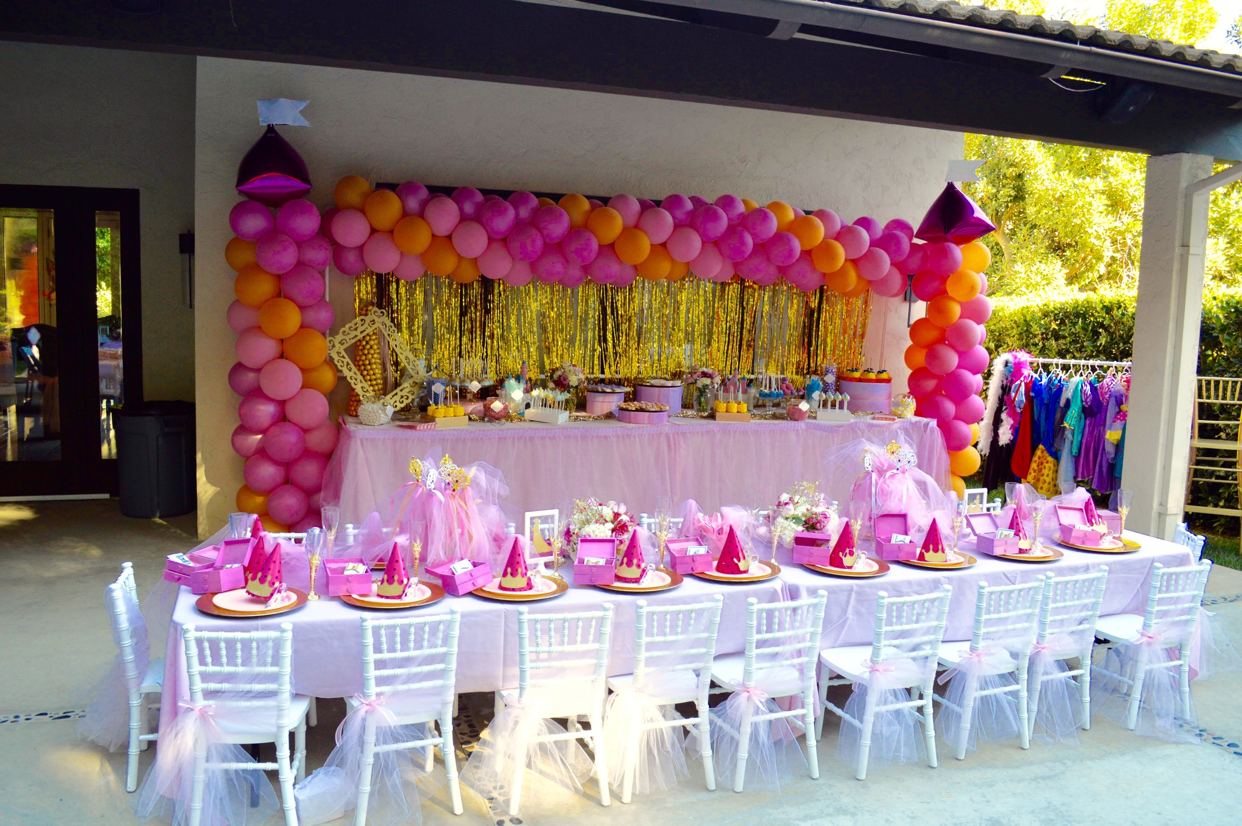 The dessert table was 12 feet long and feature a gold mylar shimmer backdrop paired with a Balloon arch by  Total Package Balloons  by Carolyn Baker.