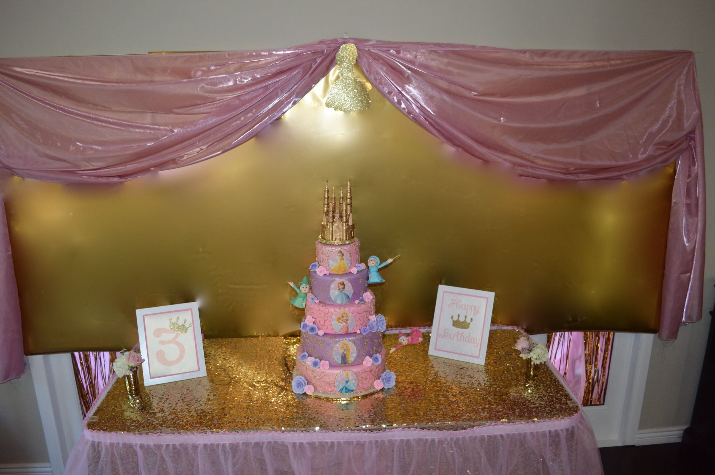 Backdrop created by Down Emery Lane. Cake by Sweet Art Bakery.