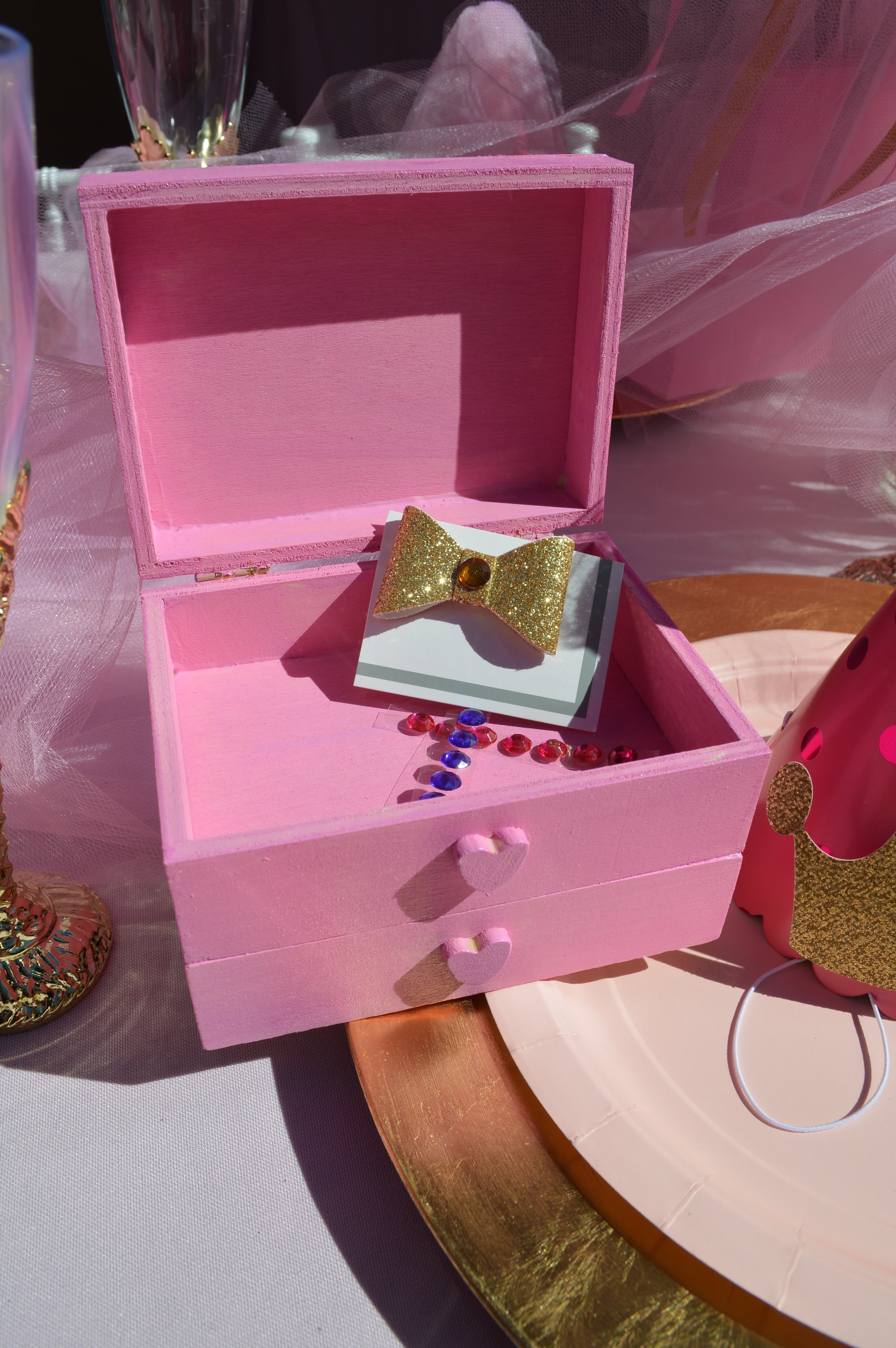 Each guest was given a pink wooden jewelry box with a bow and rhinestones for decorating.