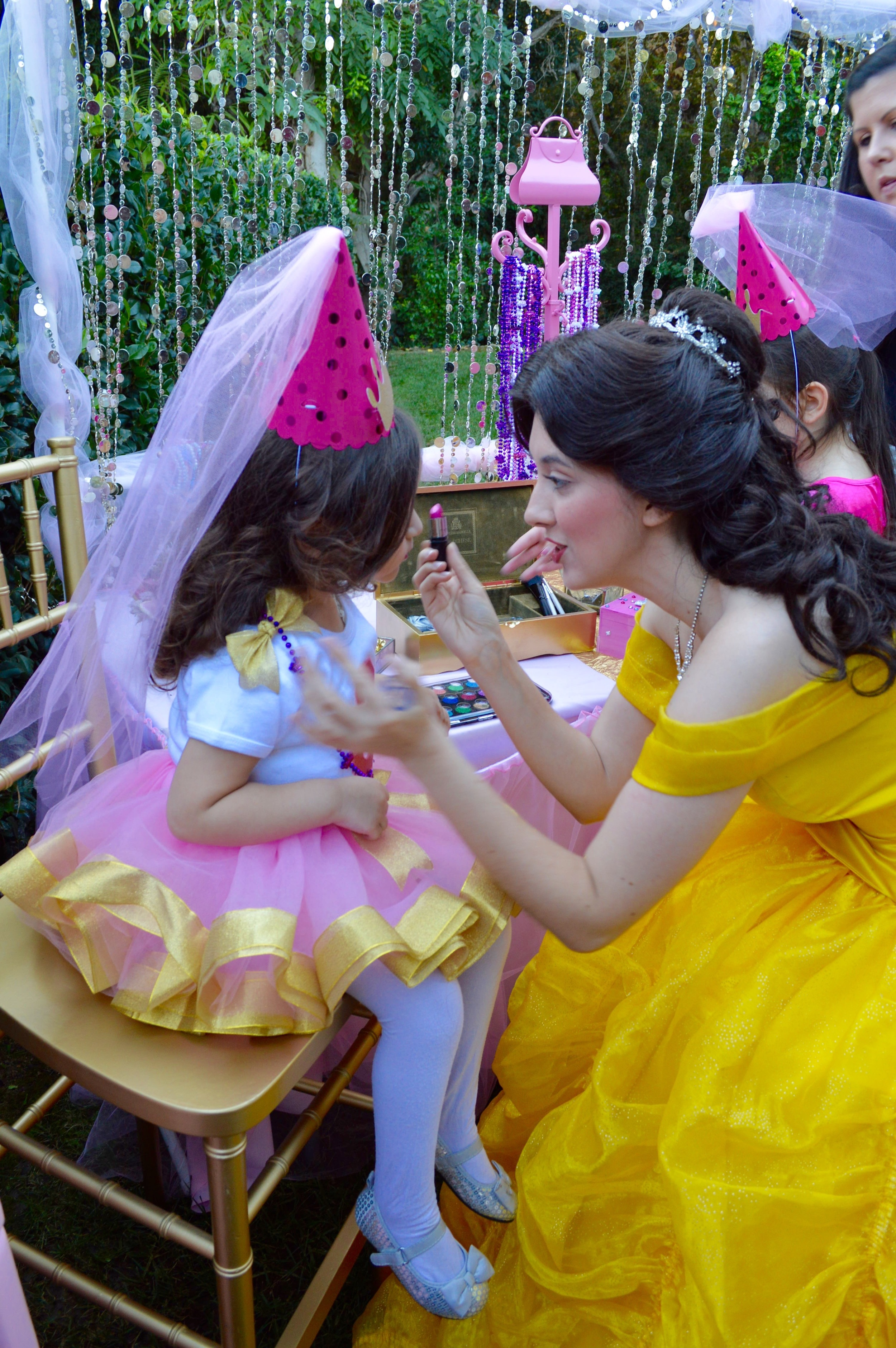 Belle stopped by for an hour to help the ladies with their makeup. Belle provided by  Wishing Well Entertainment .