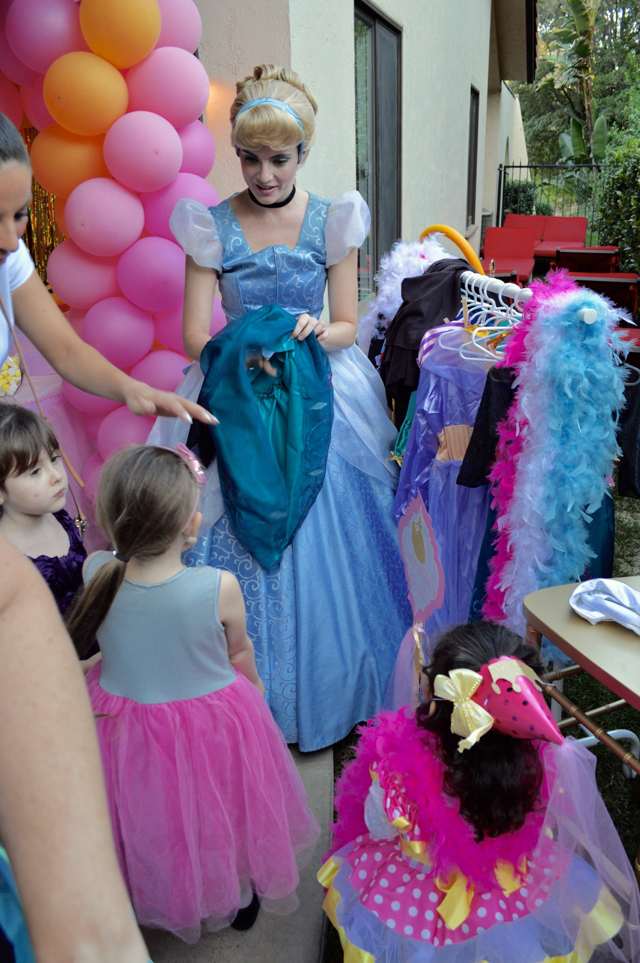 "Cinderella helped the guests find something from ""Cinderella's Closet"" to wear for the party."