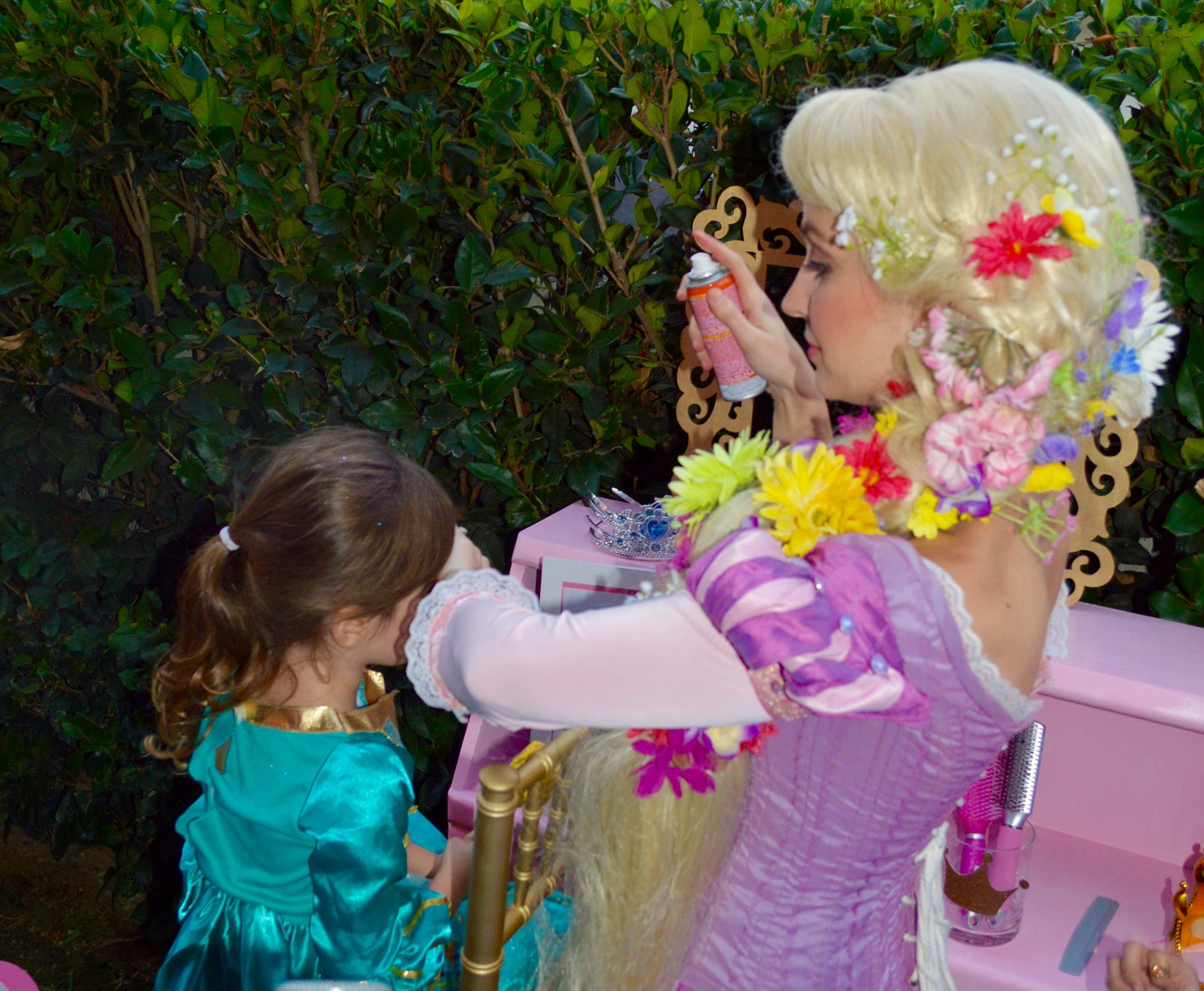 Who better to style your long locks than Rapunzel herself?! Rapunzel appeared courtesy of  Wishing Well Entertainment .