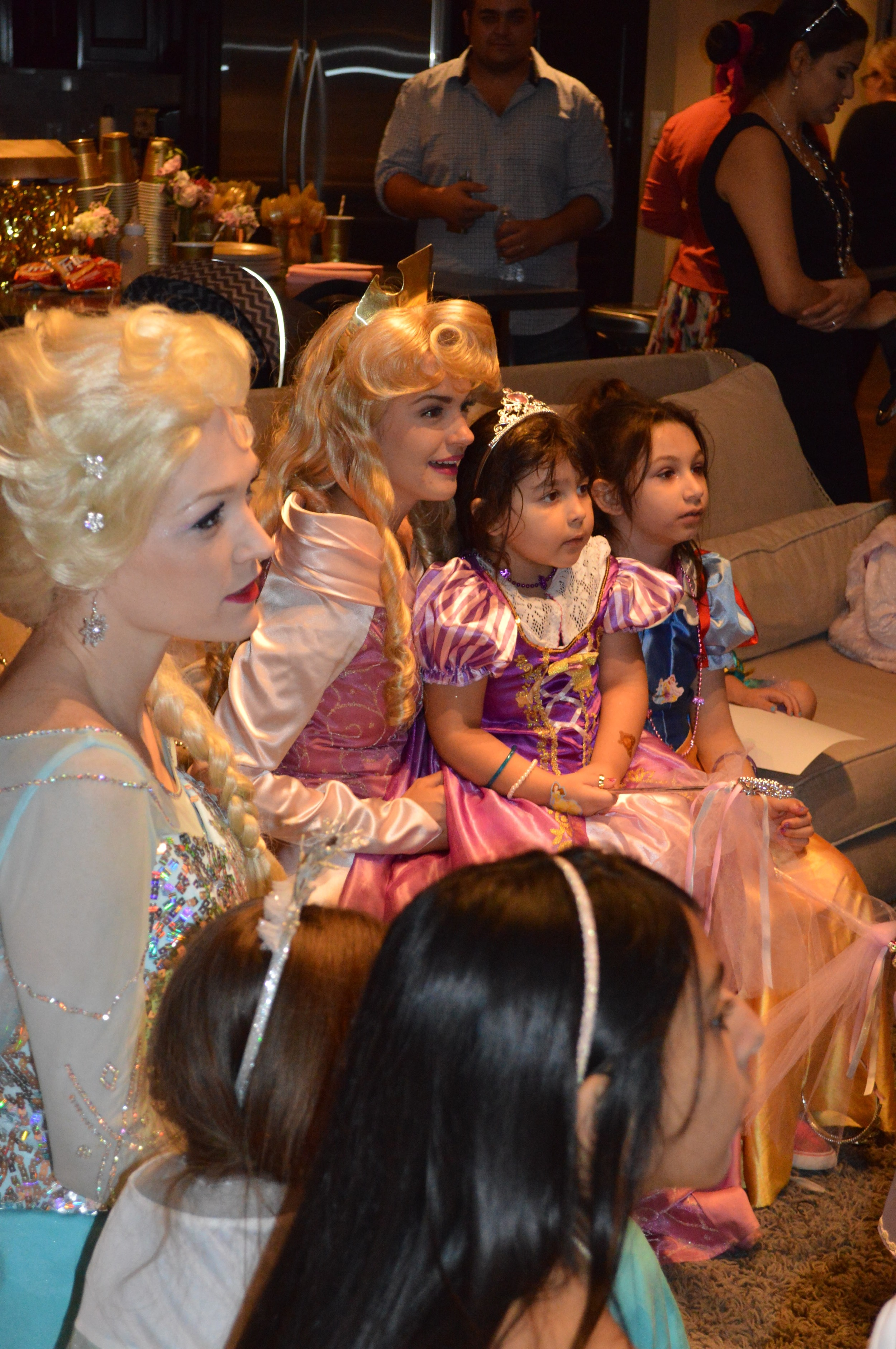 Sleeping Beauty and Elsa stayed to watch the puppet show with the kids!