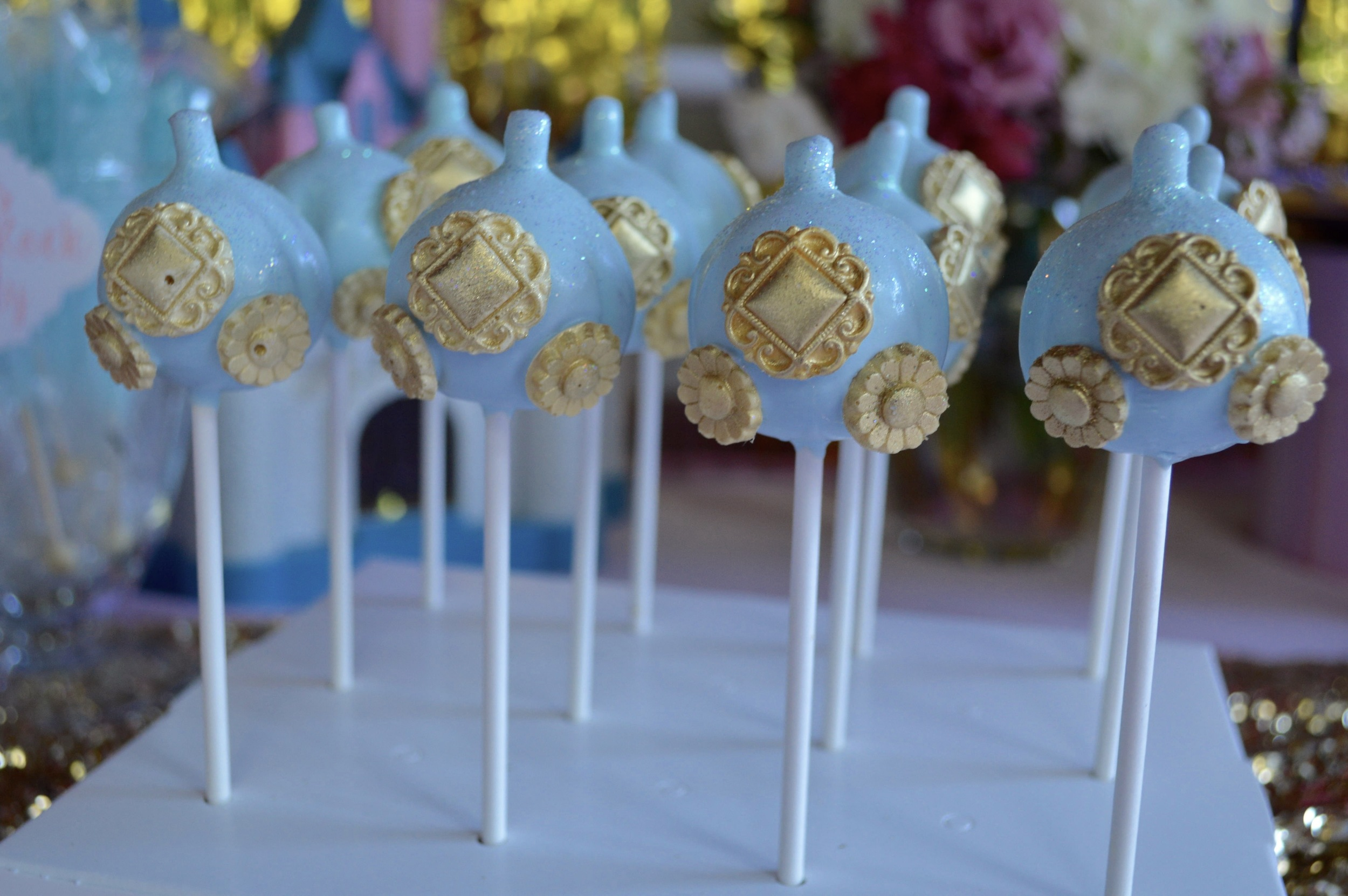 Cinderella carriage cake pops by  Just a Bite Creations .