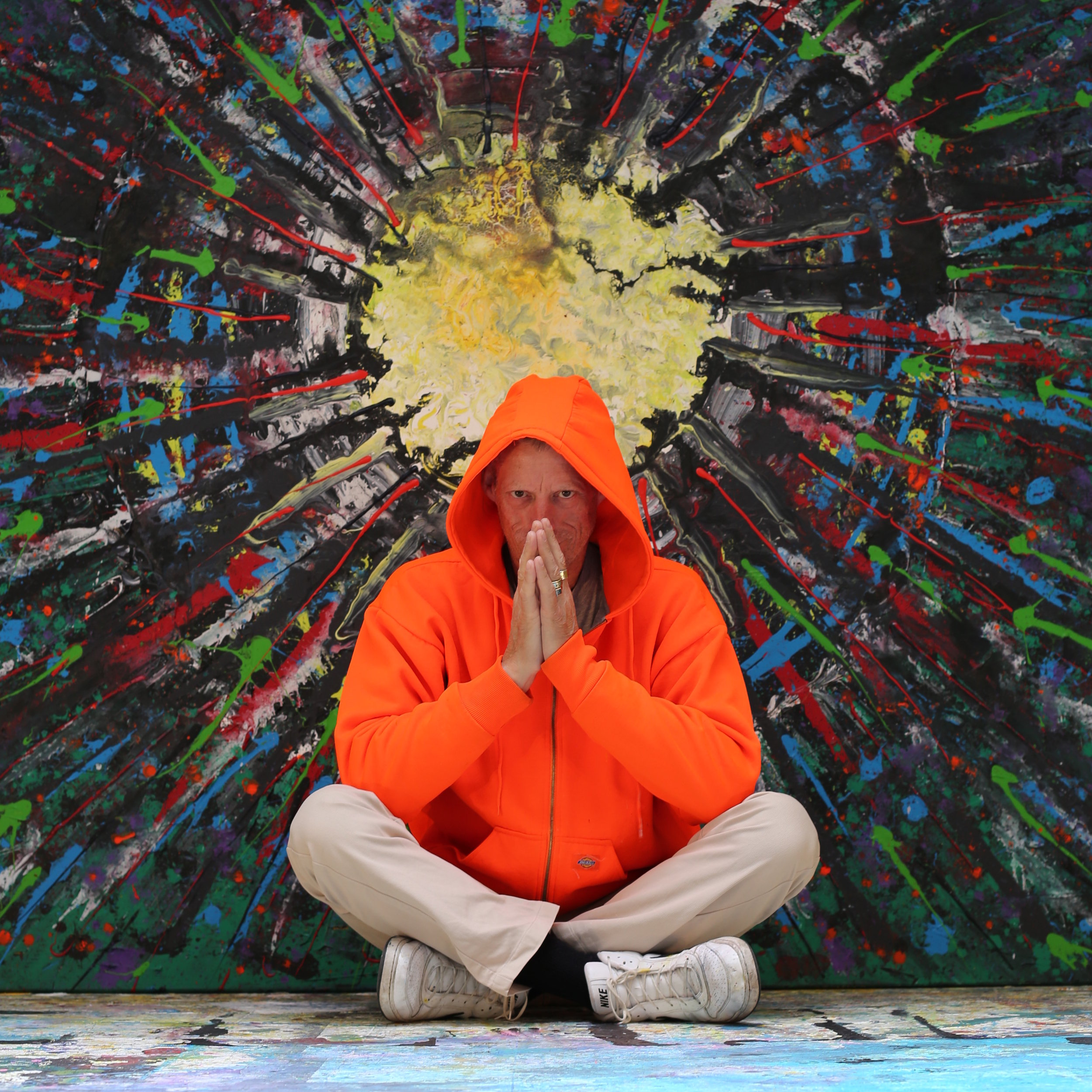European artist Harry van Gestel in front of his big abstract painting