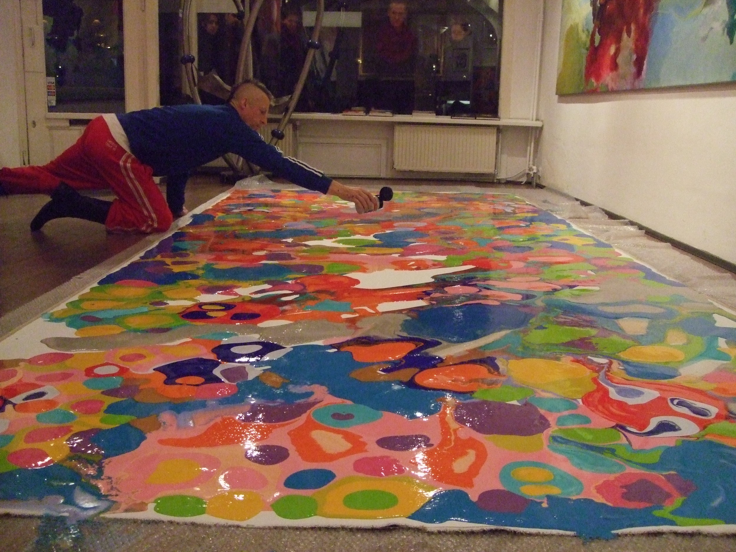 Harry van Gestel working on a big canvas in his gallery in Amsterdam, The Netherlands