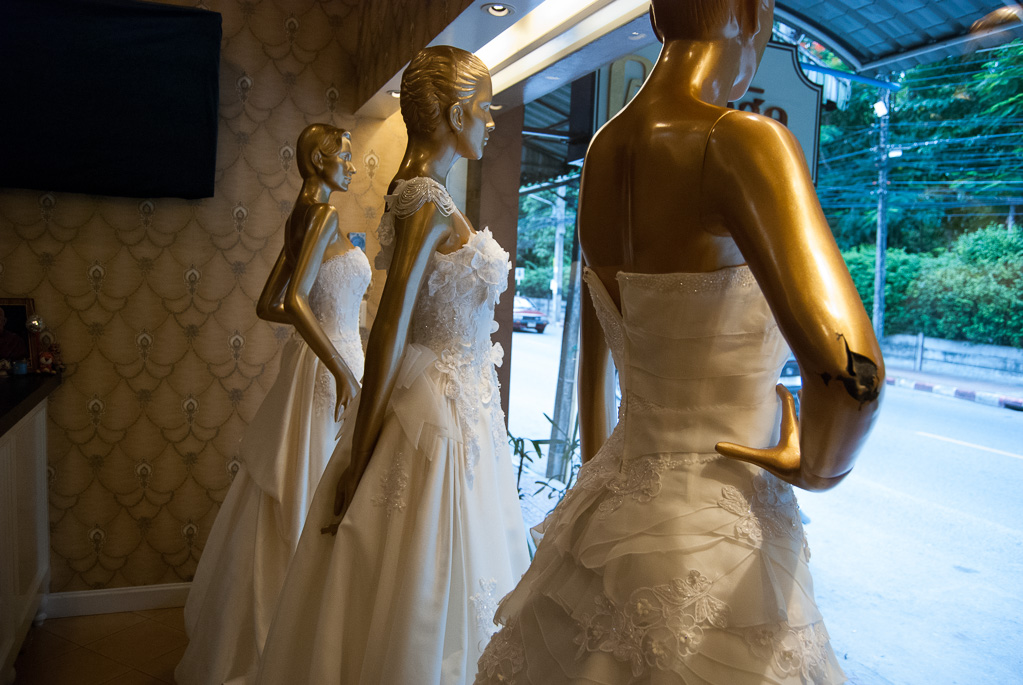 White wedding gowns in store window, Classic Studio, Nakhon Si Thammarat City