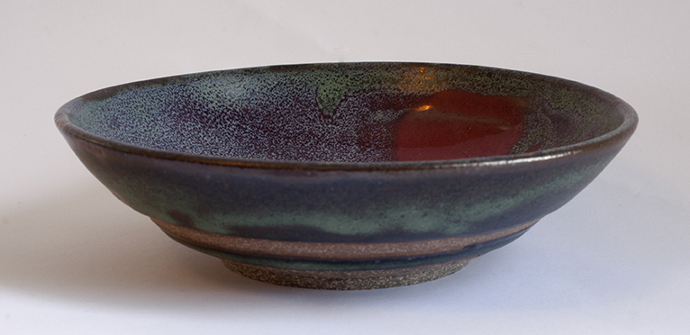 Cranberry colbat green bowl from side.jpg