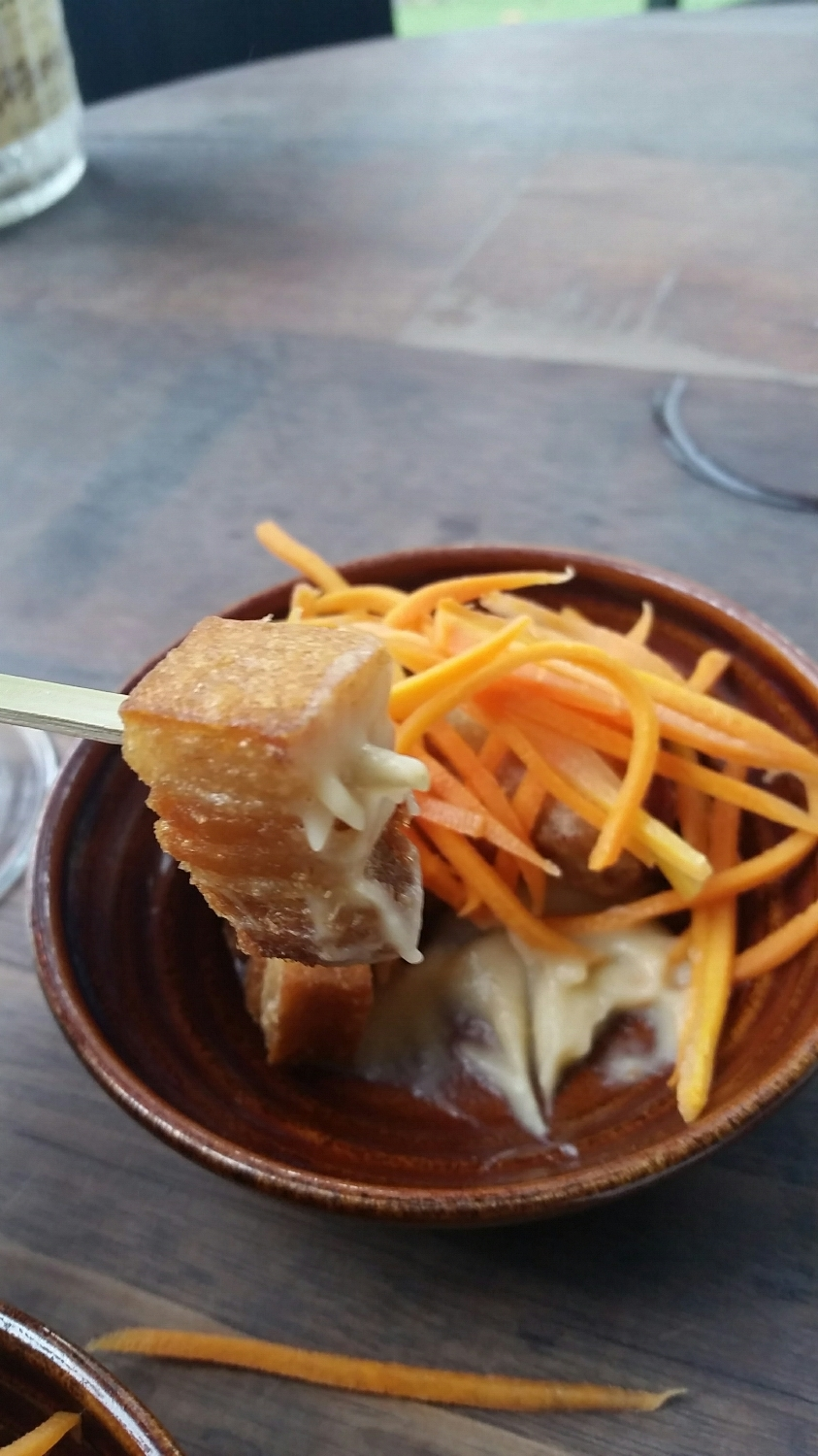 Pork belly covered in pickled carrots and sitting on a bed of a sweet apple puree. It was crispy on the outside then rich and fatty from the inside.