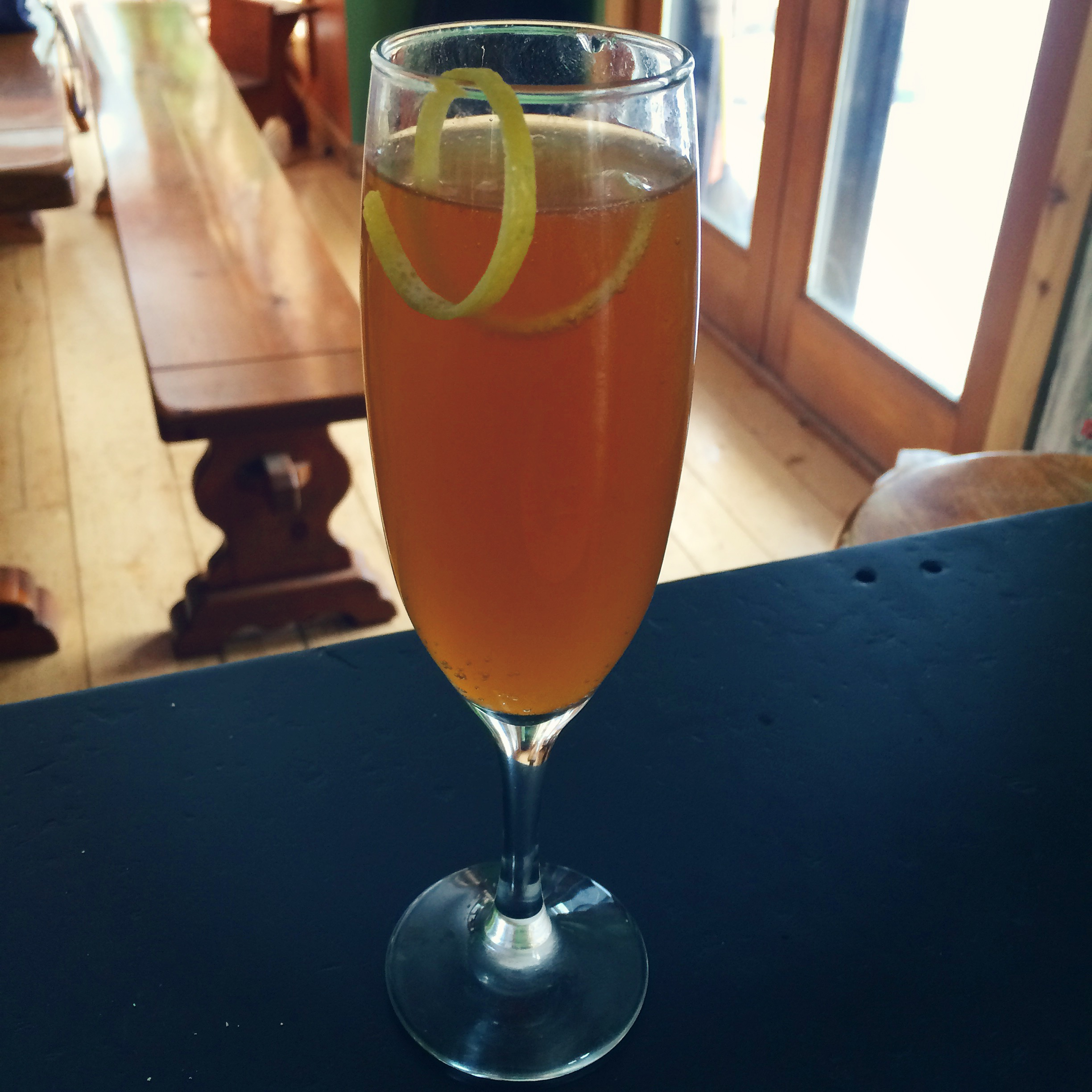 Apple Cider Mimosa with a twist of lemon