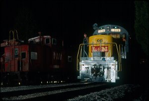Looking like a scene from Coal Country, L&N 1315 is lit up parked next to an N&W caboose.