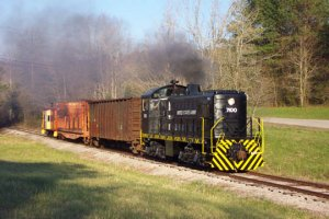 The freight train exits the woods surrounding Watts Bar Lake near the end of the rail line.