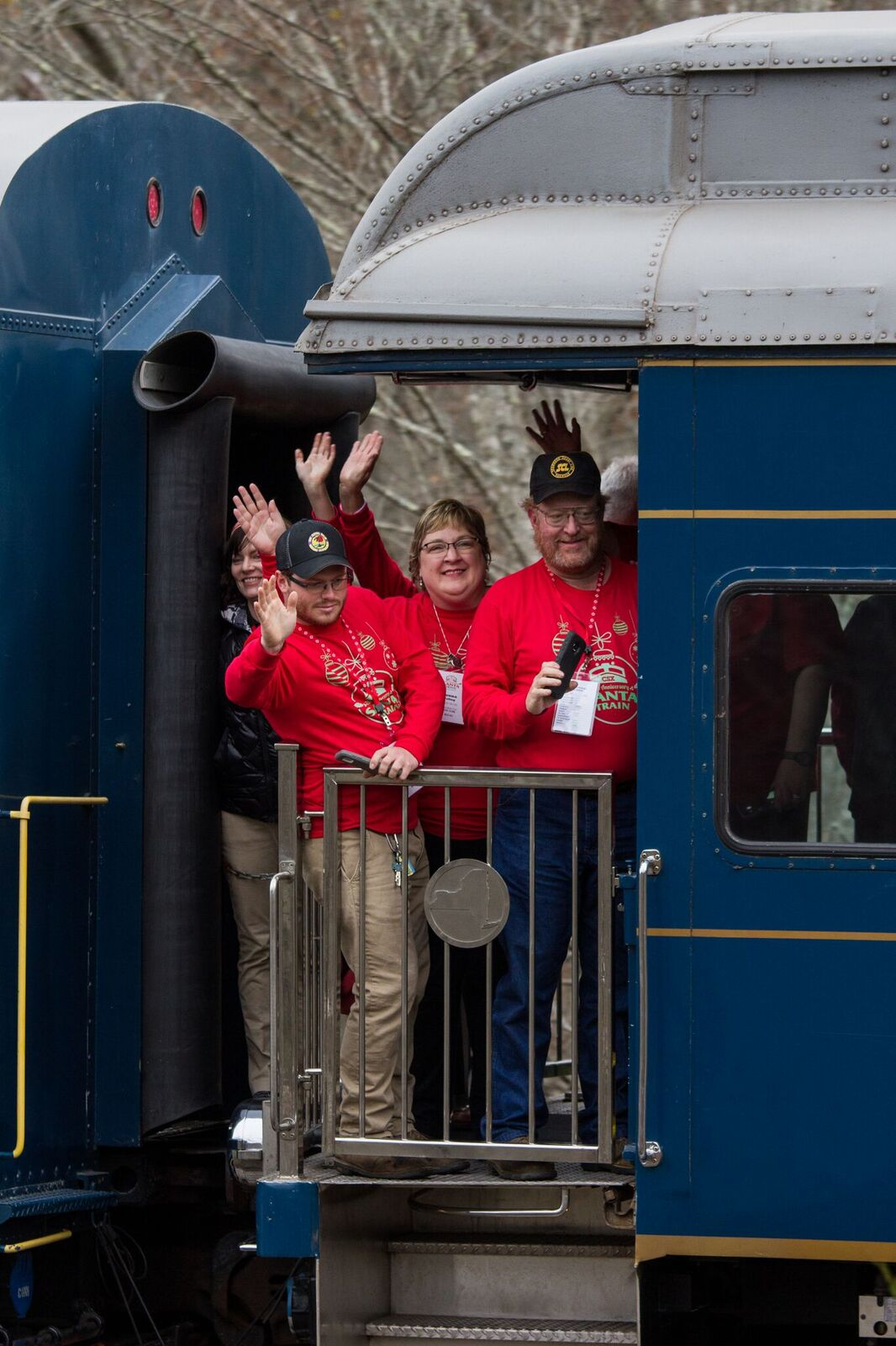 Museum Director Charlie Poling and his wife, plus museum volunteer Wade White ride the Santa Train. Peyton Gupton photo.