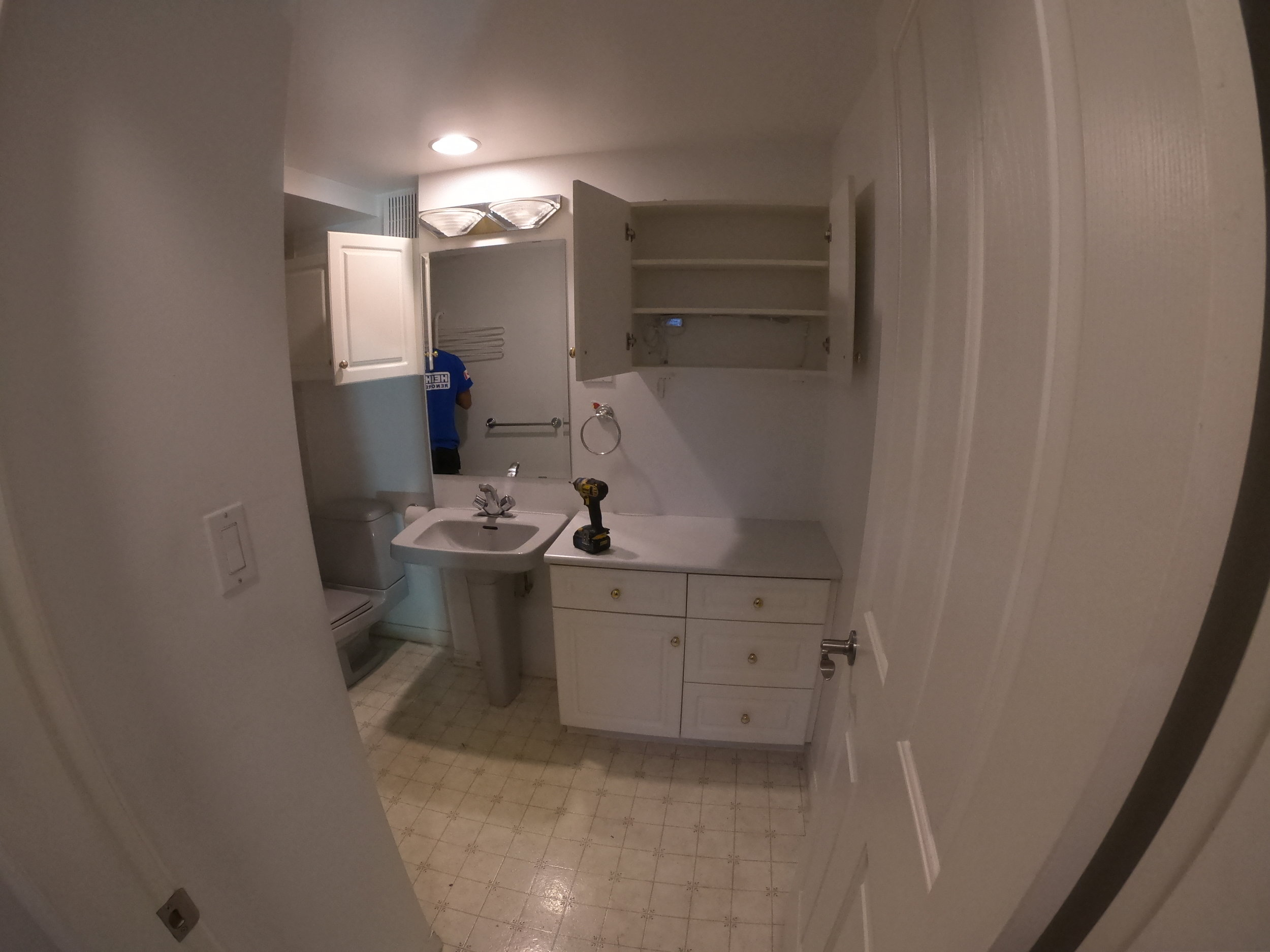 Old vanity, toilet, and cabinets in this North Vancouver Renovation