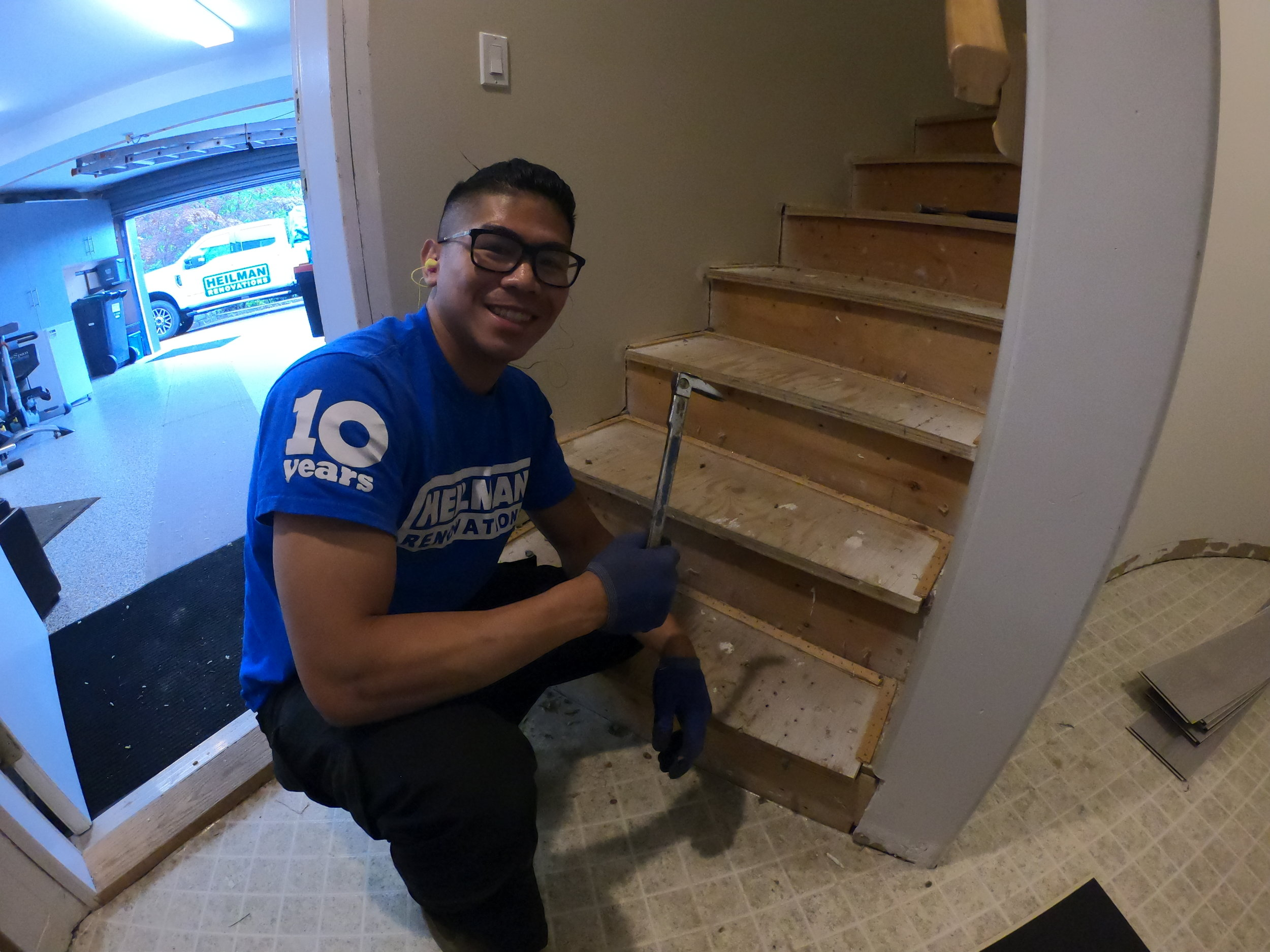 Anthony removing carpet on the stairwell for this North Vancouver Renovation