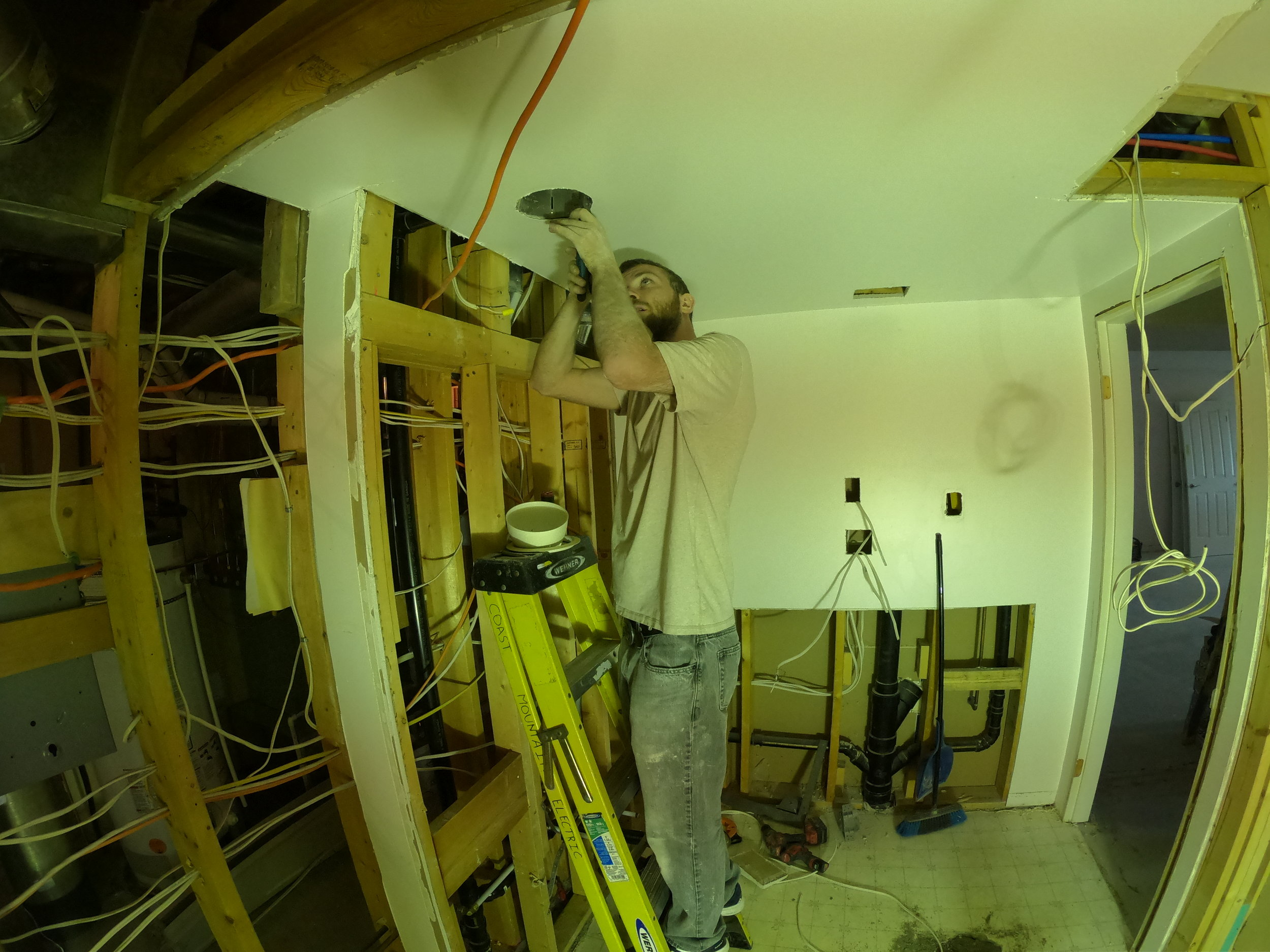 Cole the electrician Installing pot lights for this North Vancouver Renovation